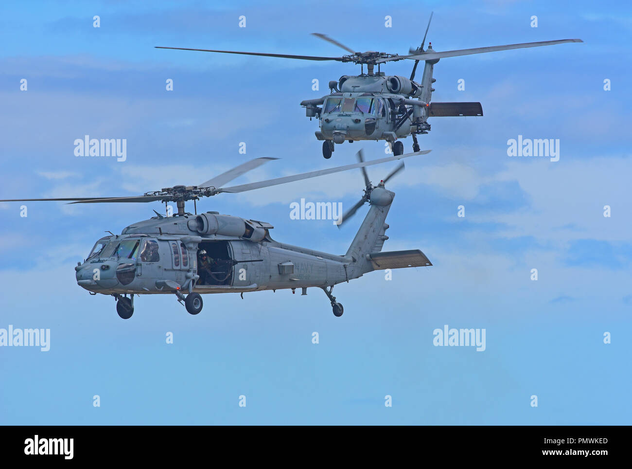 USNAVY MH-60 Seahawk helicopter on gunnery training exercise at Tain range, flying out from the RAF base at Lossiemouth in Moray, Scotland. Stock Photo