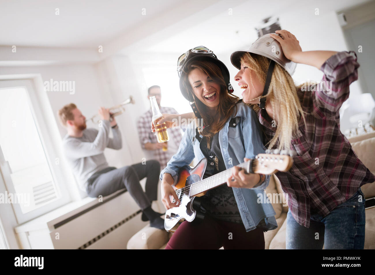 Group of friends having fun, partying and drinking - Stock Image