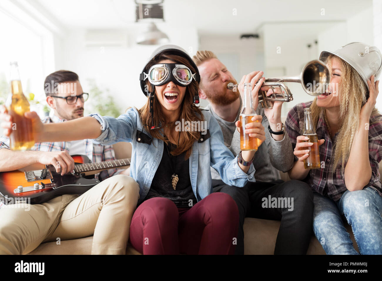 Young students and friends celebrating ahd having fun while drinking - Stock Image