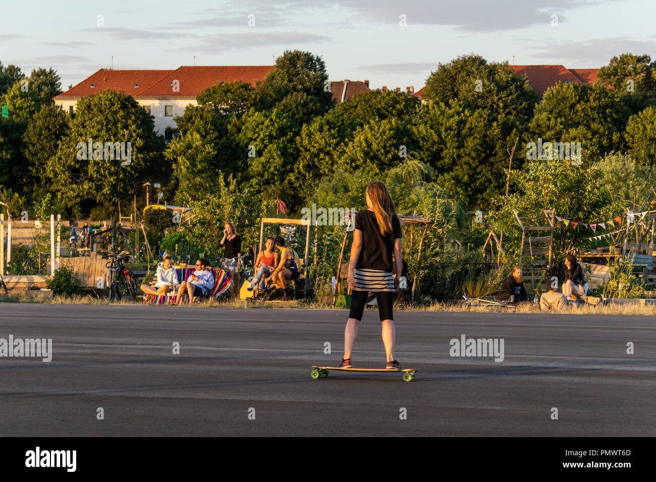 Tempelhofer Feld, roller scater at former airport area Tempelhof, urban garden, alternative scene, Berlin - Stock Image