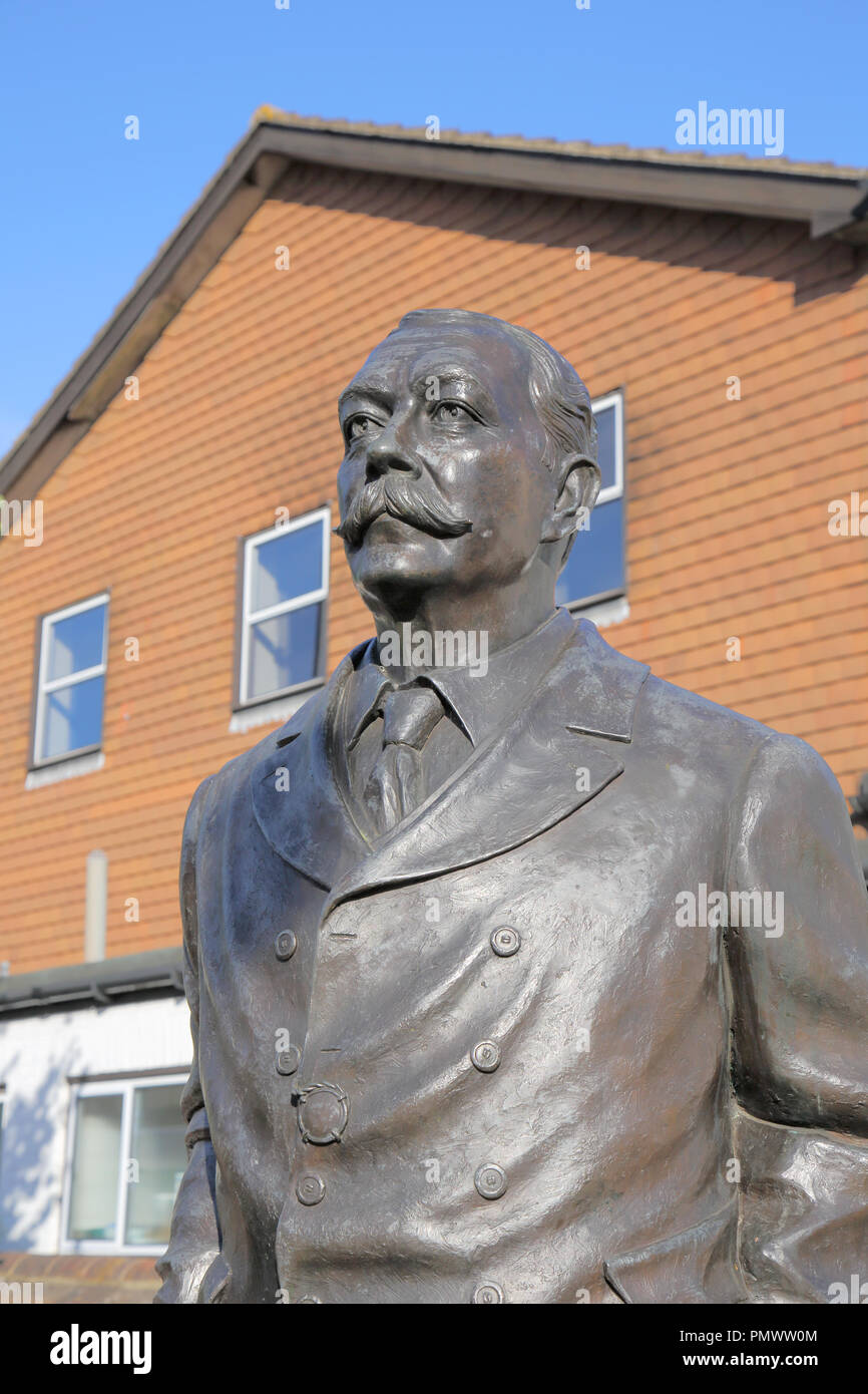 statue of sir arthur conan doyle who lived in crowborough in east sussex - Stock Image