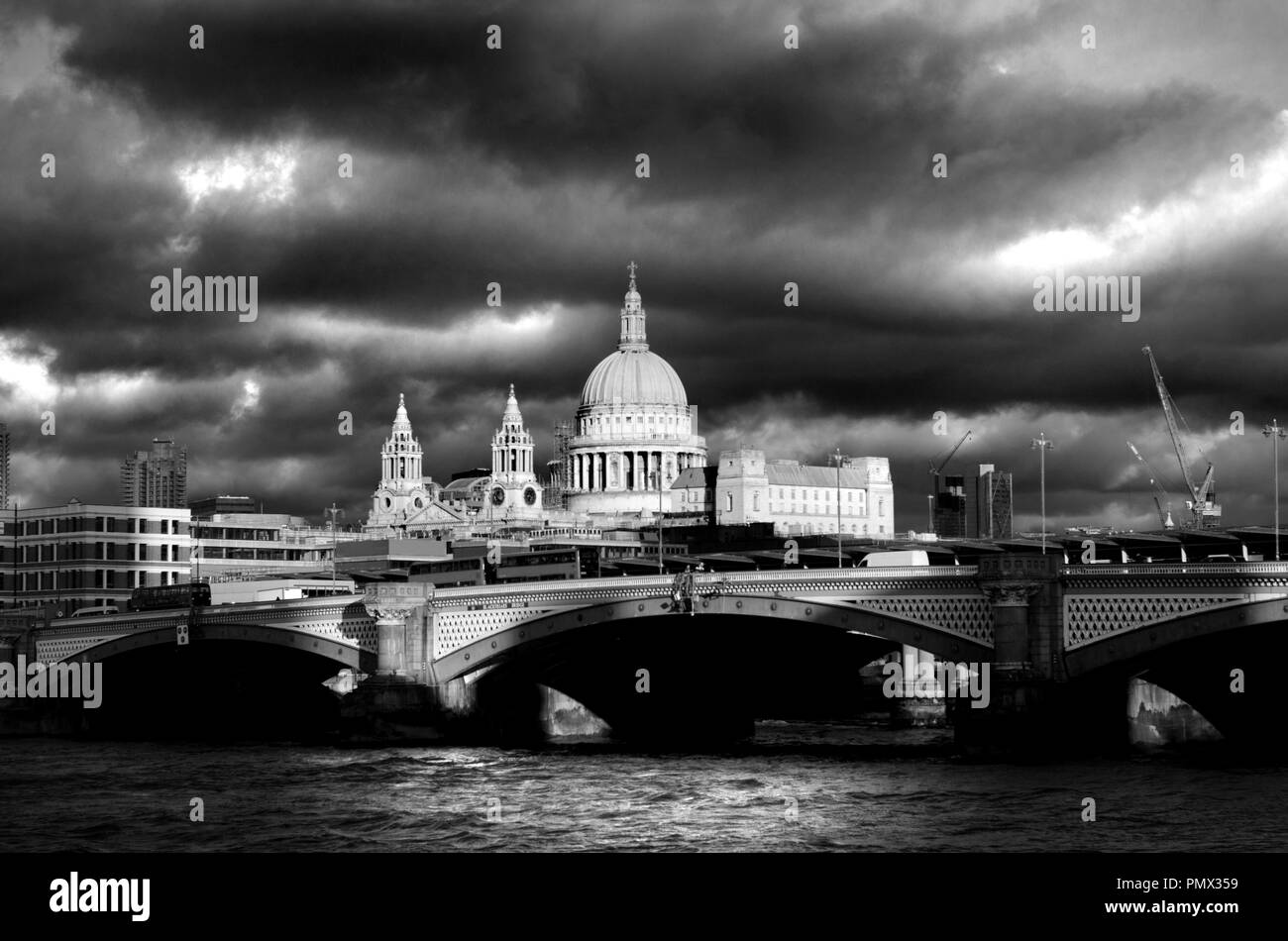 London, England, UK. St Paul's Cathedral, River Thames and Blackfriars Bridge on a dramatic cloudy day in December - Stock Image