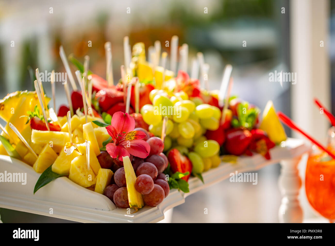 Assortment of fruit offered to guests at a wedding reception party. Holidays Stock Photo