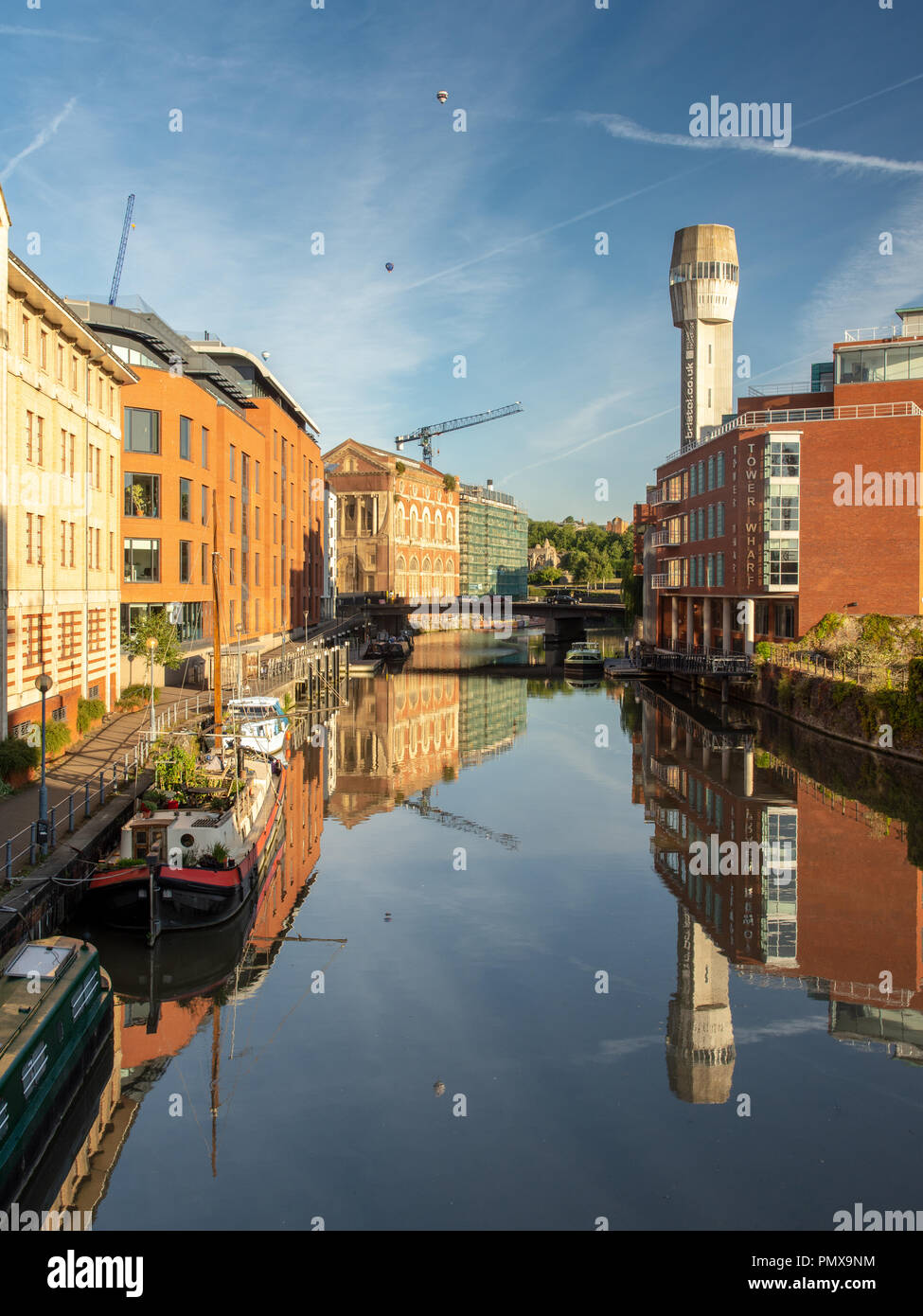 Bristol, England, UK - August 11, 2018: Hot air balloons fly across Bristol's Floating Harbour at dawn during the annual Balloon Fiesta. - Stock Image