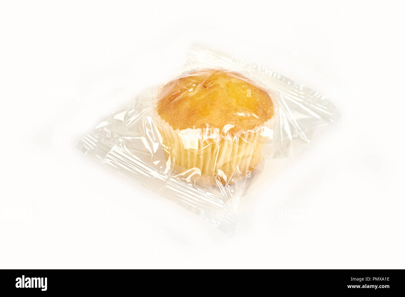 muffins packed in transparent packaging, on a white background. - Stock Image