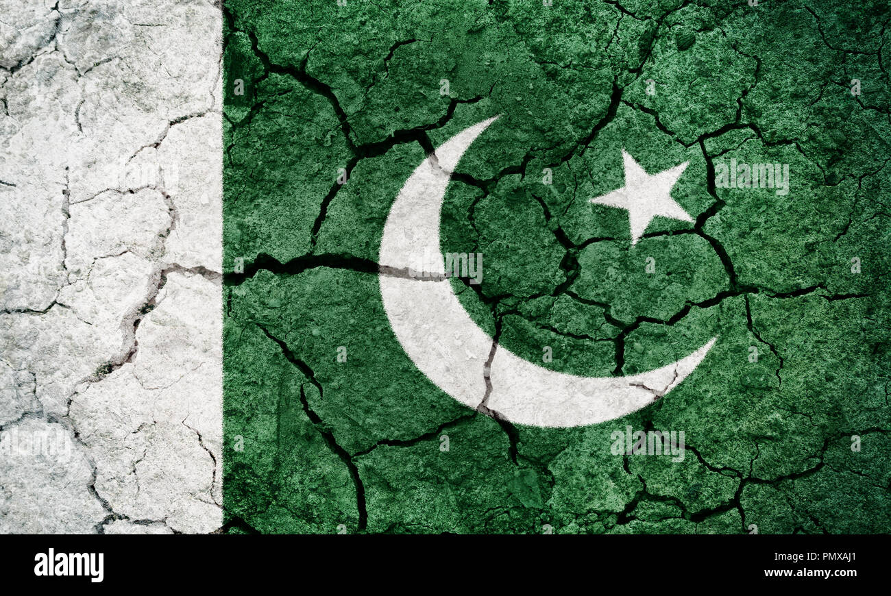 Islamic Republic Of Pakistan Flag On Dry Earth Ground Texture