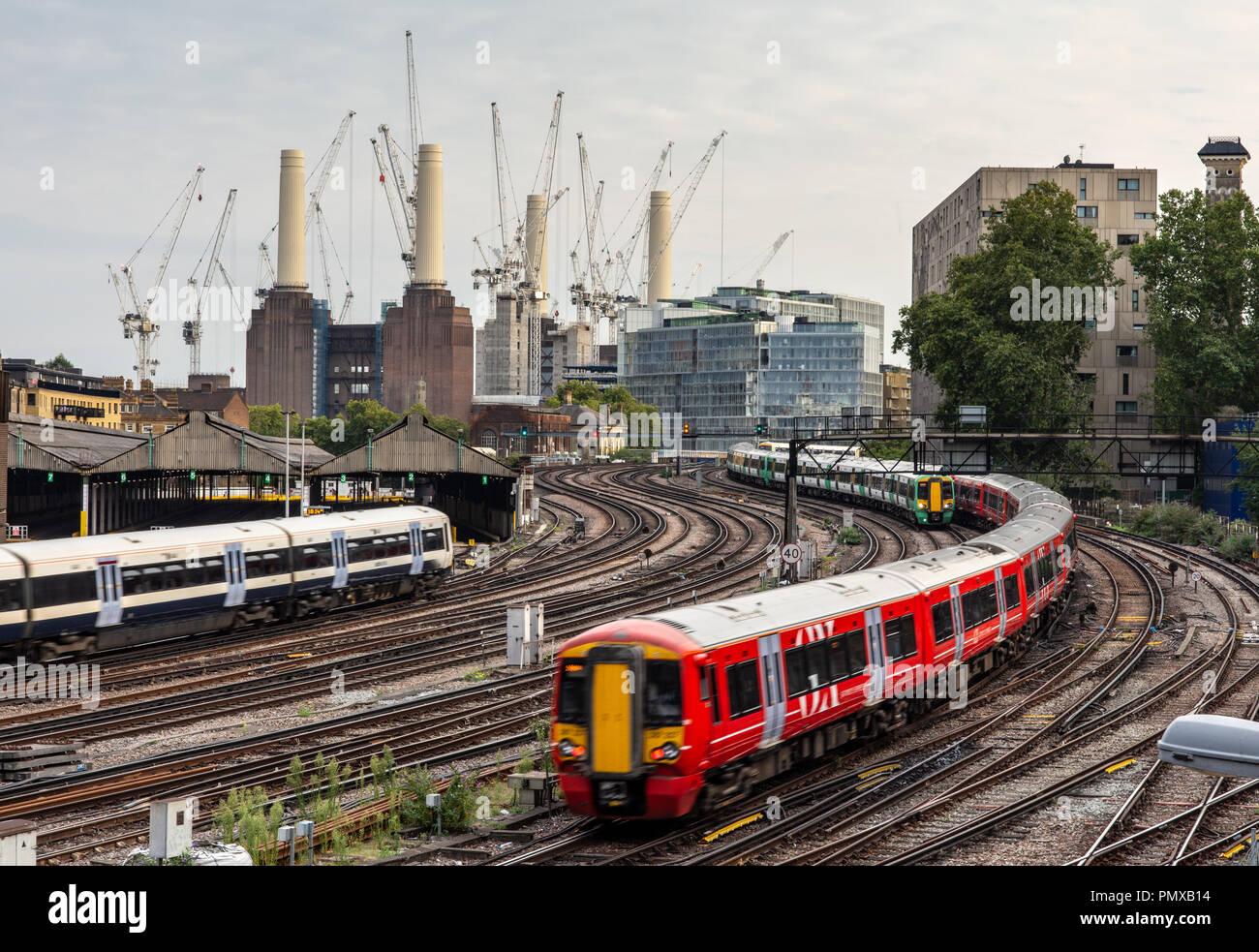 London, England, UK - September 5, 2018: Southern, Southeastern and Gatwick Express commuter passenger trains pass outside London's Victoria station w - Stock Image