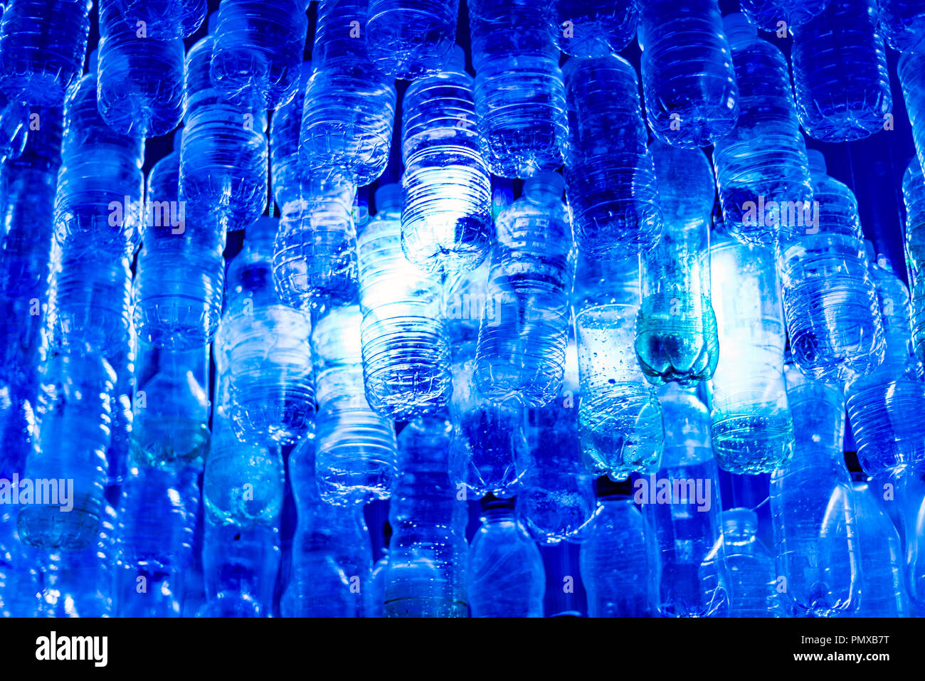 Installation made from bottles recovered from ocean at the Southampton Boat Show 2018 illustrating the amount of plastics in the oceans. - Stock Image