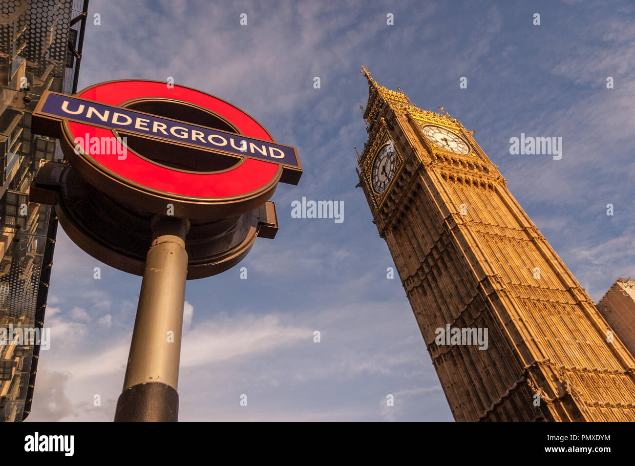 London, England, UK - September 18, 2010: The Elizabeth clock tower, home of Big Ben, rises from the Houses of Parliament beside Westminster tube stat Stock Photo