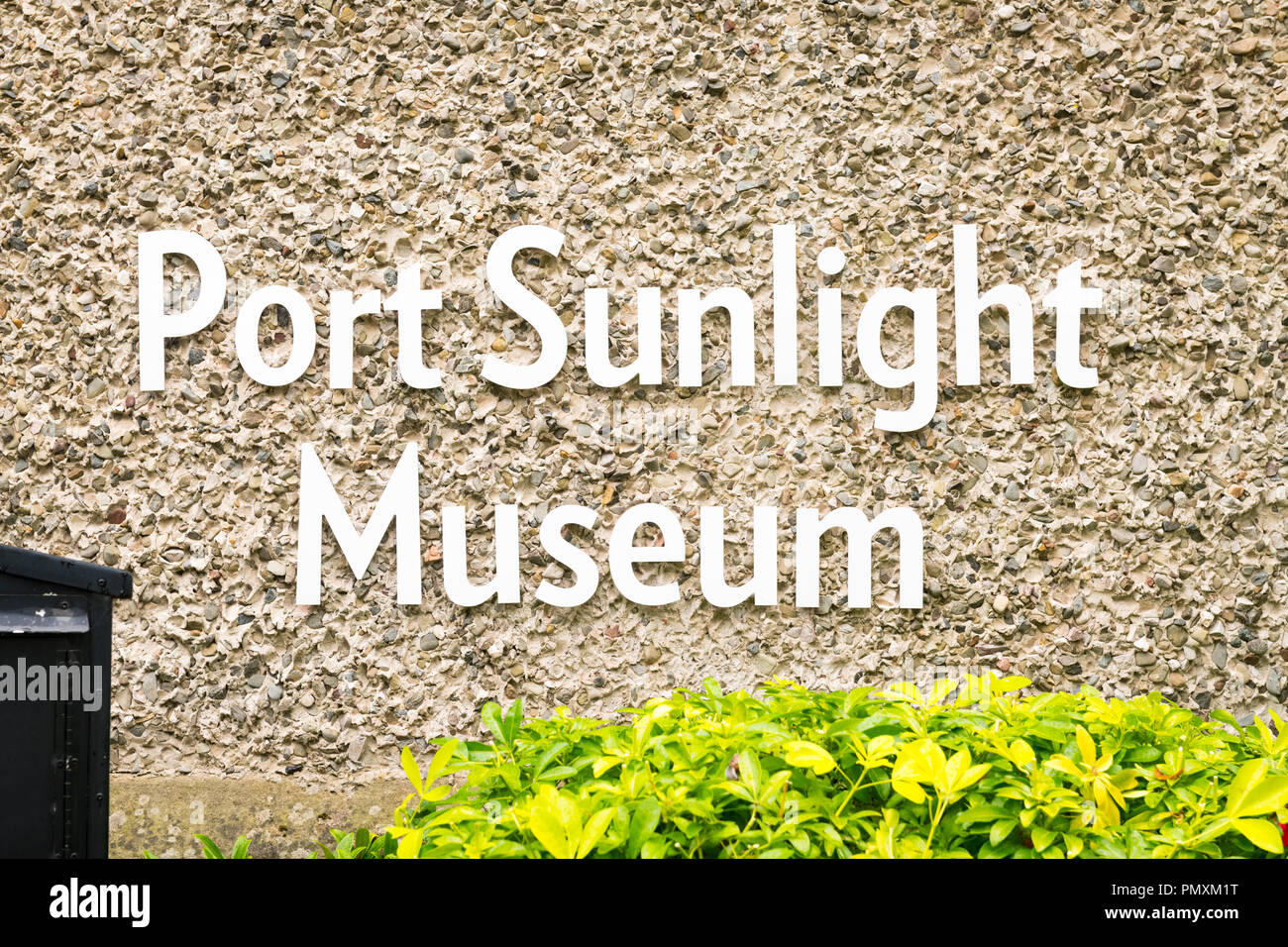 Liverpool Wirral Port Sunlight Village Museum sign signage on pebbledash wall entrance bush hedge history soap William Hasketh Lever his enterprises - Stock Image