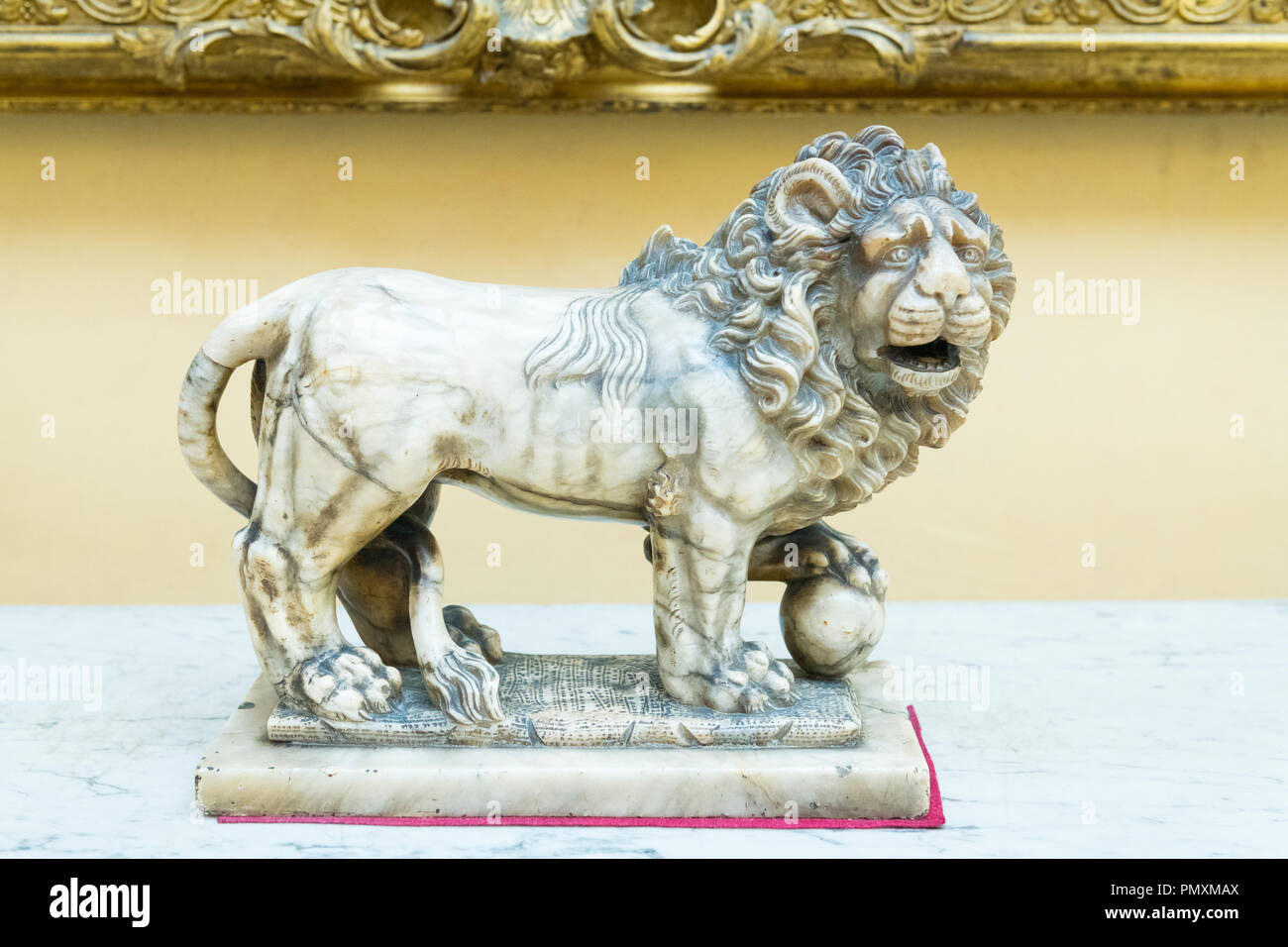 Liverpool Wirral Port Sunlight Village The Lady Lever Art Gallery white marble lion paw on ball one of pair - Stock Image
