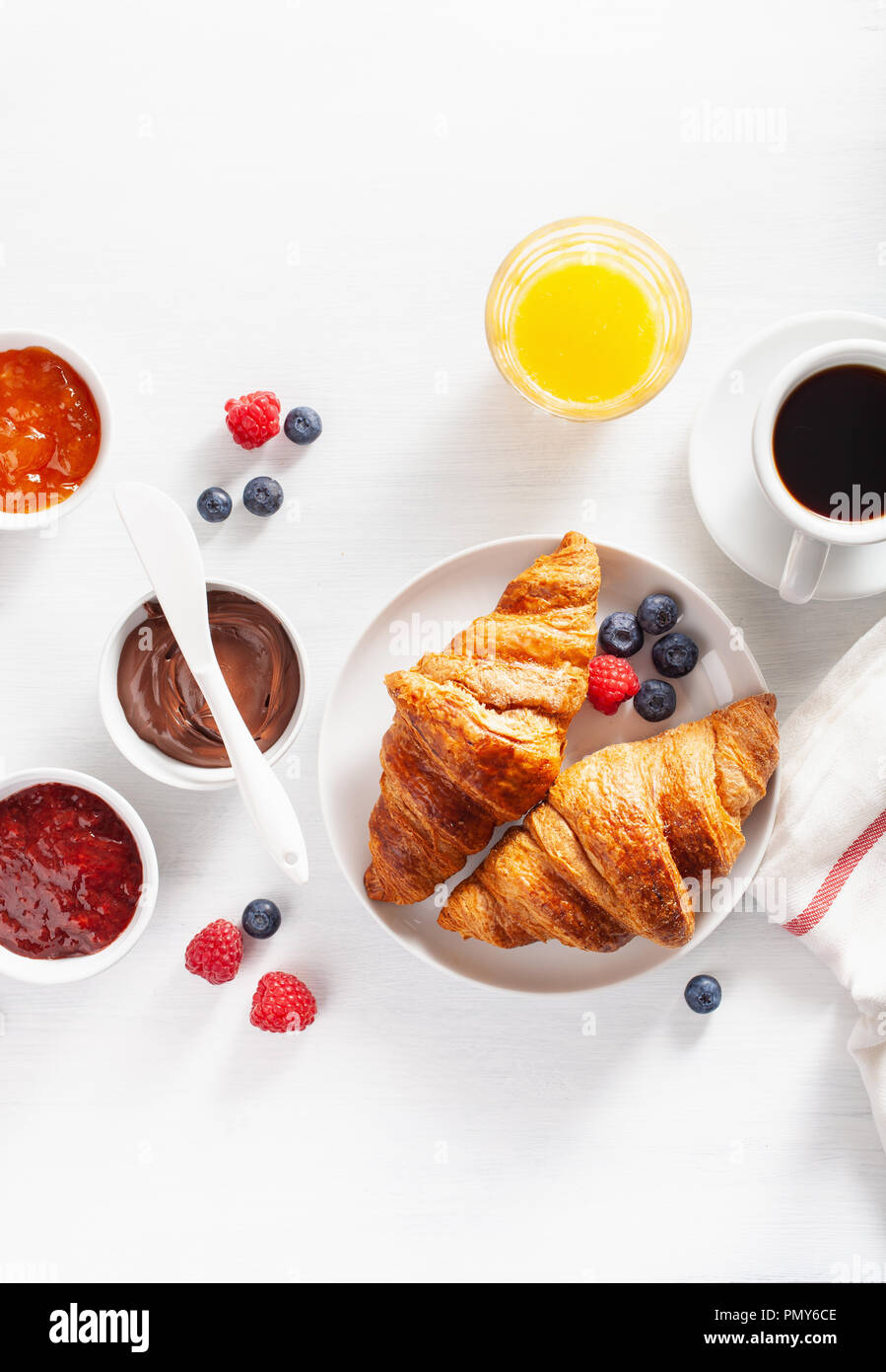 Continental breakfast with croissant, jam, chocolate spread and coffee. Top view - Stock Image