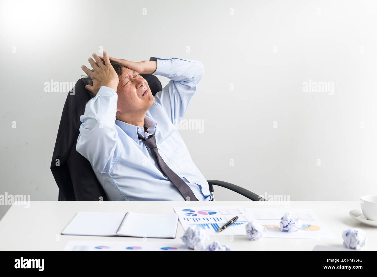 Depressed failure and tired businessman late sad and solving problem in office. in meeting room. stressed and worried at work crisis concept. - Stock Image