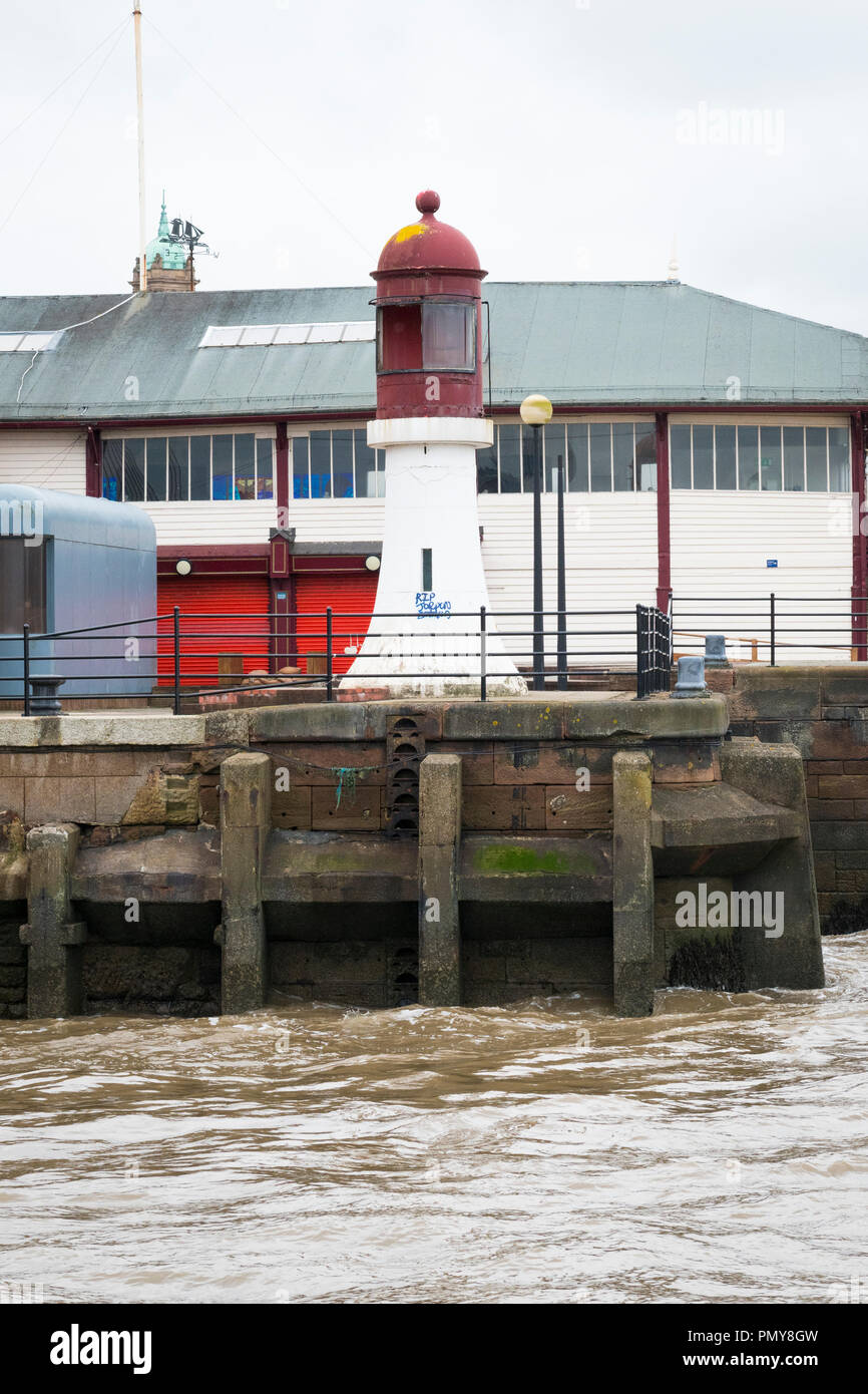 Liverpool Birkenhead Mersey Ferries Woodside Terminal Merseyside River Mersey lighthouse wharf landing mooring water graffiti - Stock Image