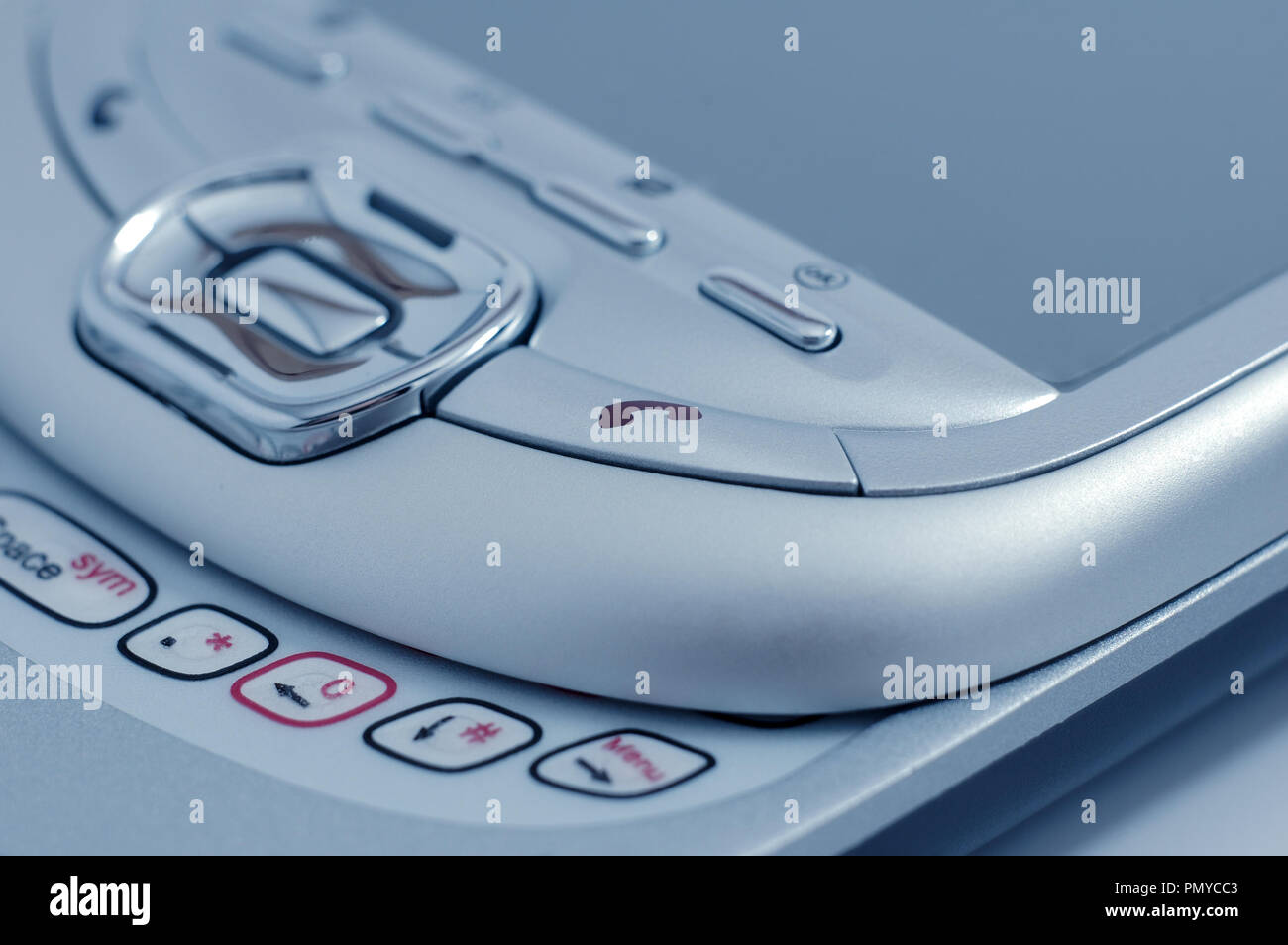 PDA. Old type mobile phone. Picture in blue tint. - Stock Image