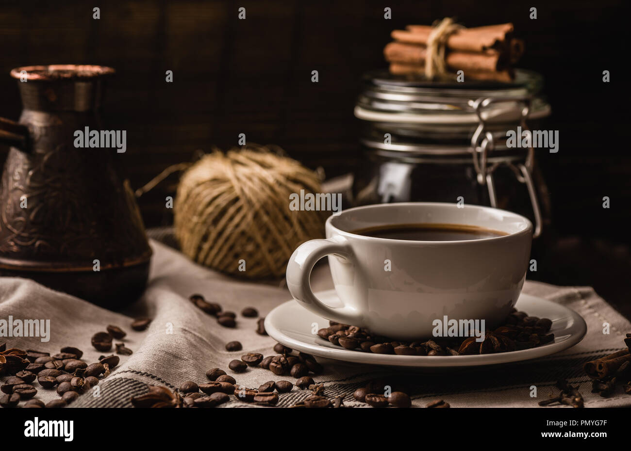 Coffee cup with various igredients, beans and kitchen equipment - Stock Image