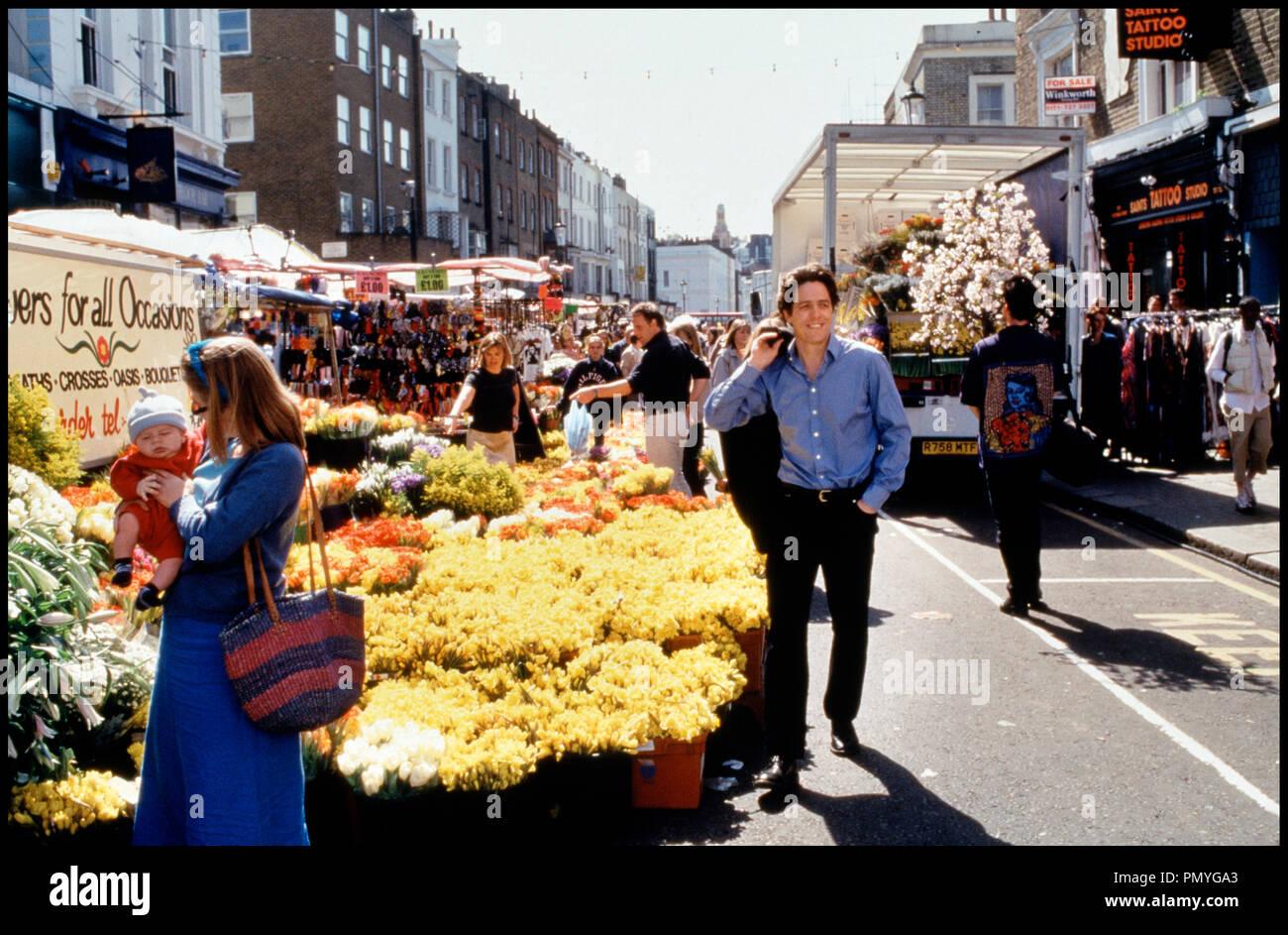 Prod DB © PolyGram - Working Title / DR COUP DE FOUDRE A NOTTING HILL (NOTTING HILL) de Roger Michell 1999 GB avec Hugh Grant marche, fleurs - Stock Image