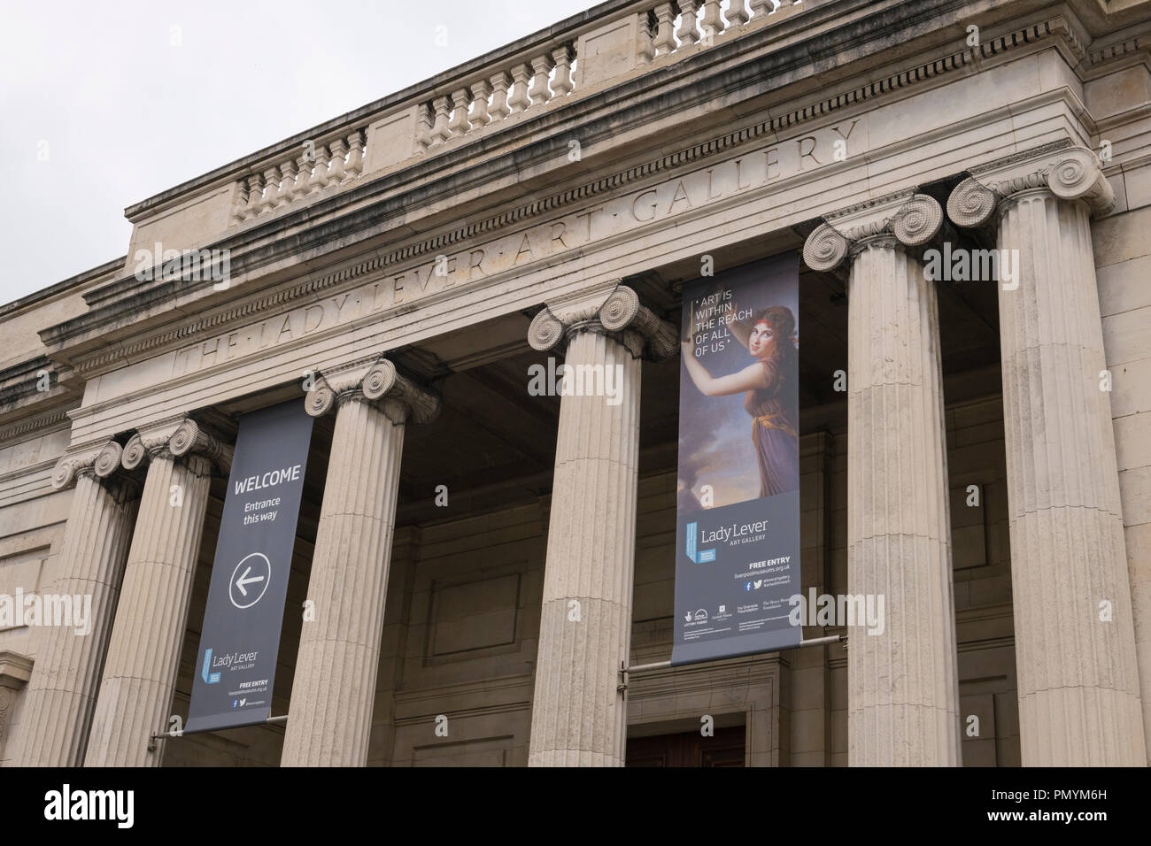 Liverpool Wirral Port Sunlight Village The Lady Lever Art Gallery banners signs exhibition neo-classical columns pillars balustrade detail - Stock Image