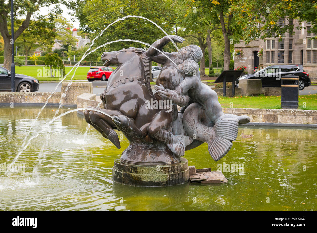 Liverpool Wirral Port Sunlight Village bronze water feature fountain Sea Spirit bronze sculpture statue by Charles Wheeler 1950 sea horse fish - Stock Image
