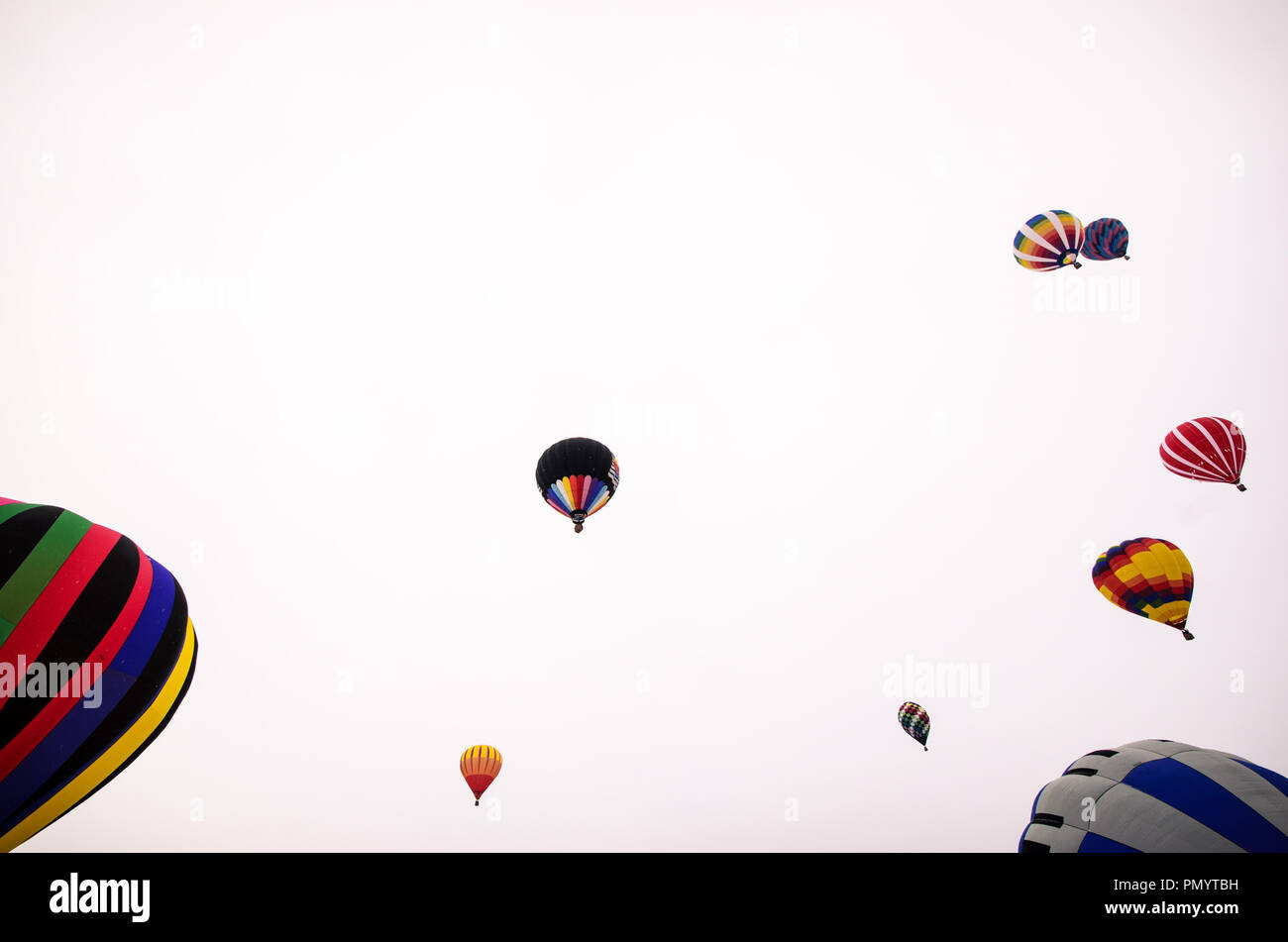 Colorful hot air balloons prepare to launch at the Hudson Hot Air Affair in winter - Stock Image