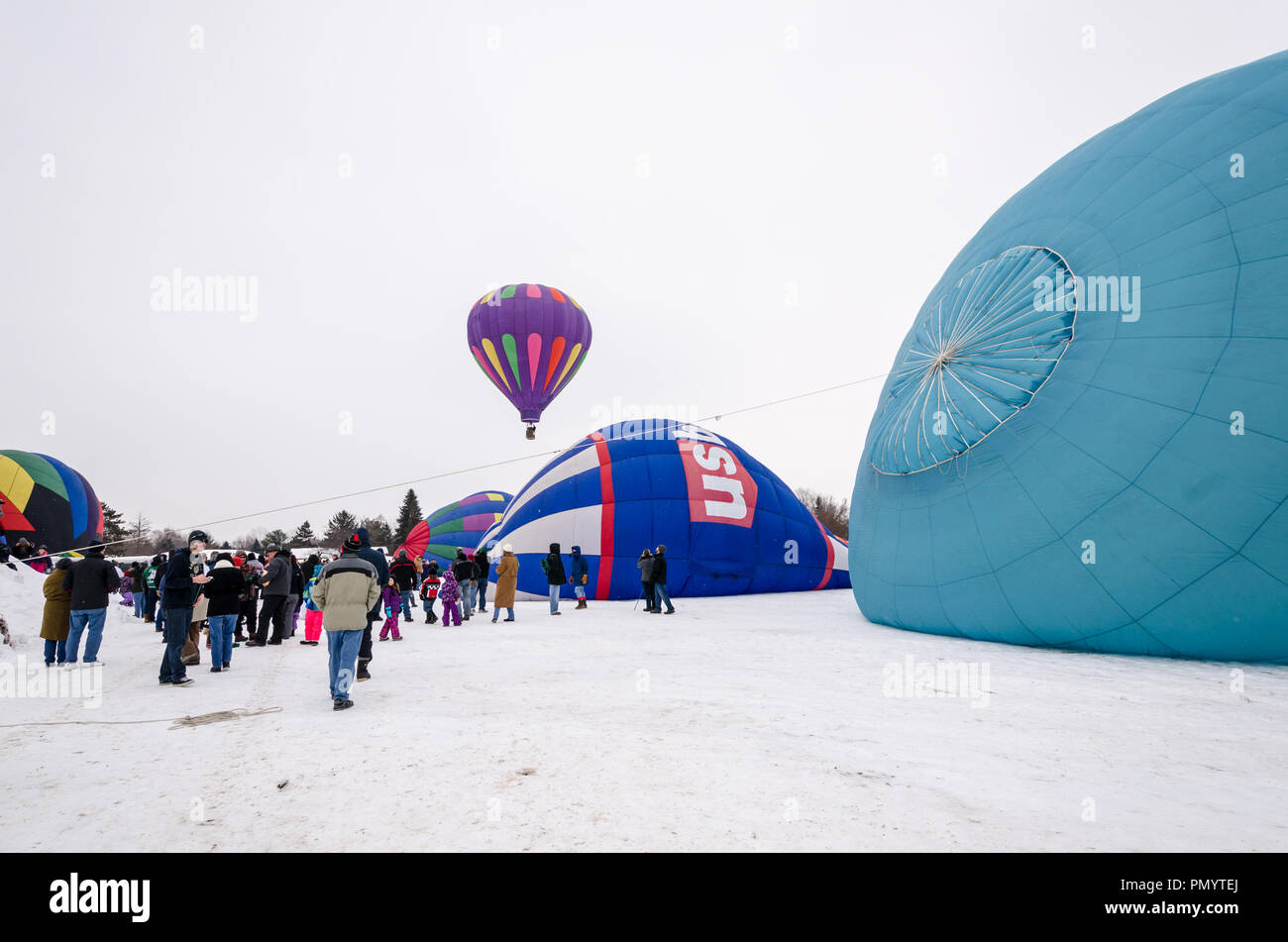 Hot air balloons prepare to be launched in the winter at the Hudson Hot Air Affair - Stock Image