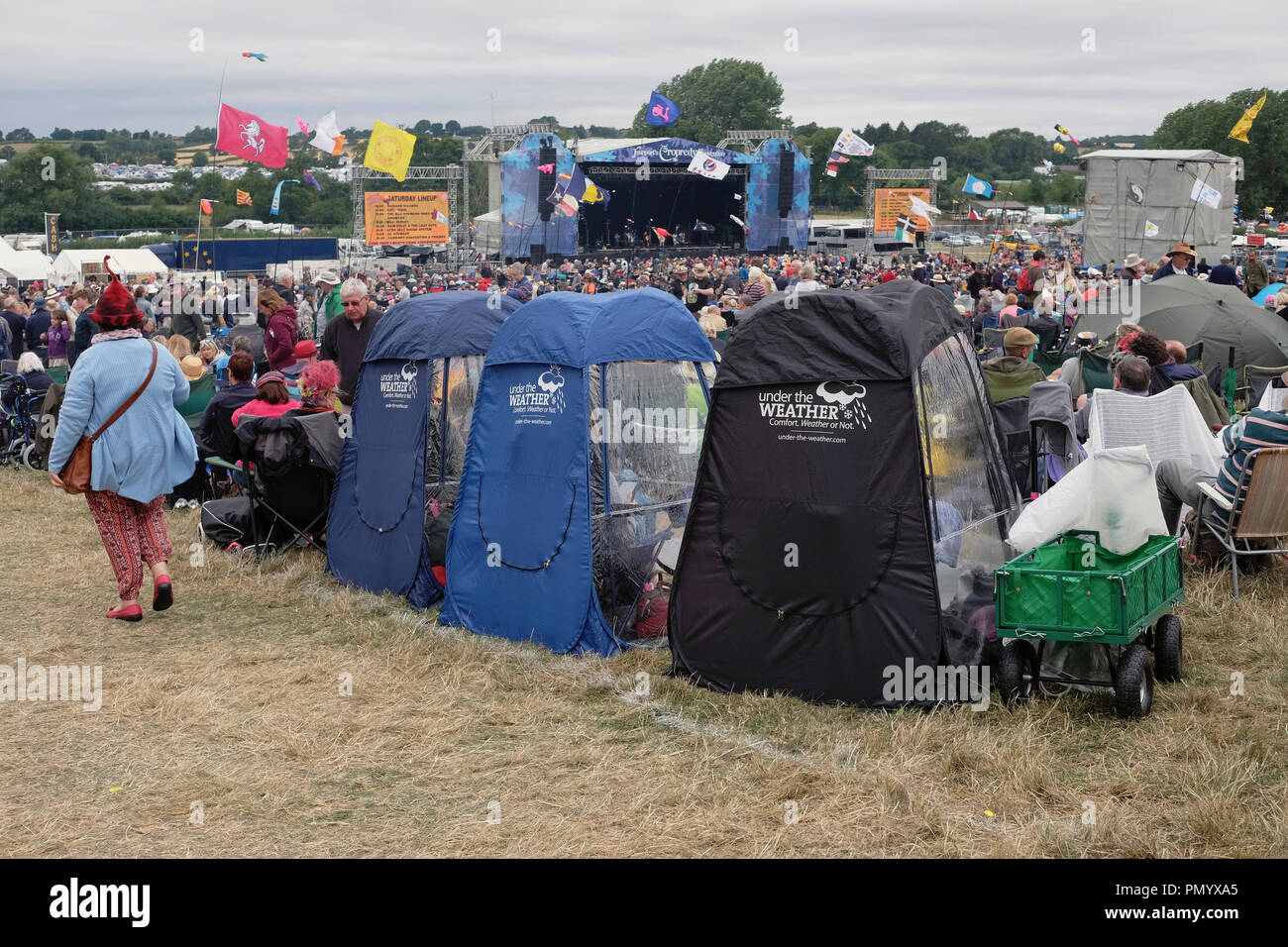 England, Oxfordshire, Three fold out chairs with weather proof plastic covers at Cropredy festival. - Stock Image