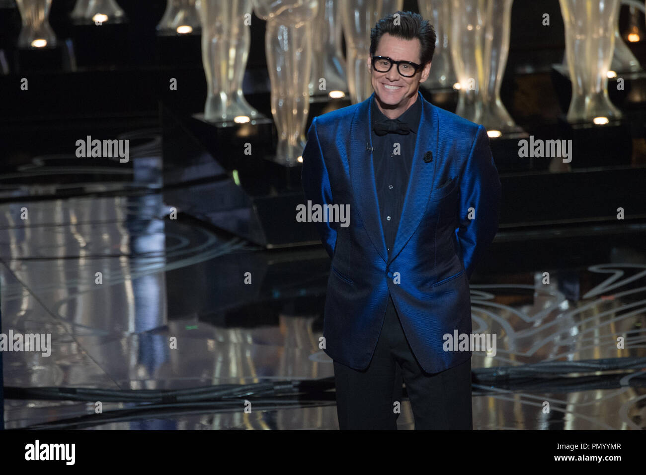 Presenter Jim Carrey on stage during the live ABC Telecast of The 86th Oscars® at the Dolby® Theatre on March 2, 2014 in Hollywood, CA.  File Reference # 32268_563  For Editorial Use Only -  All Rights Reserved - Stock Image