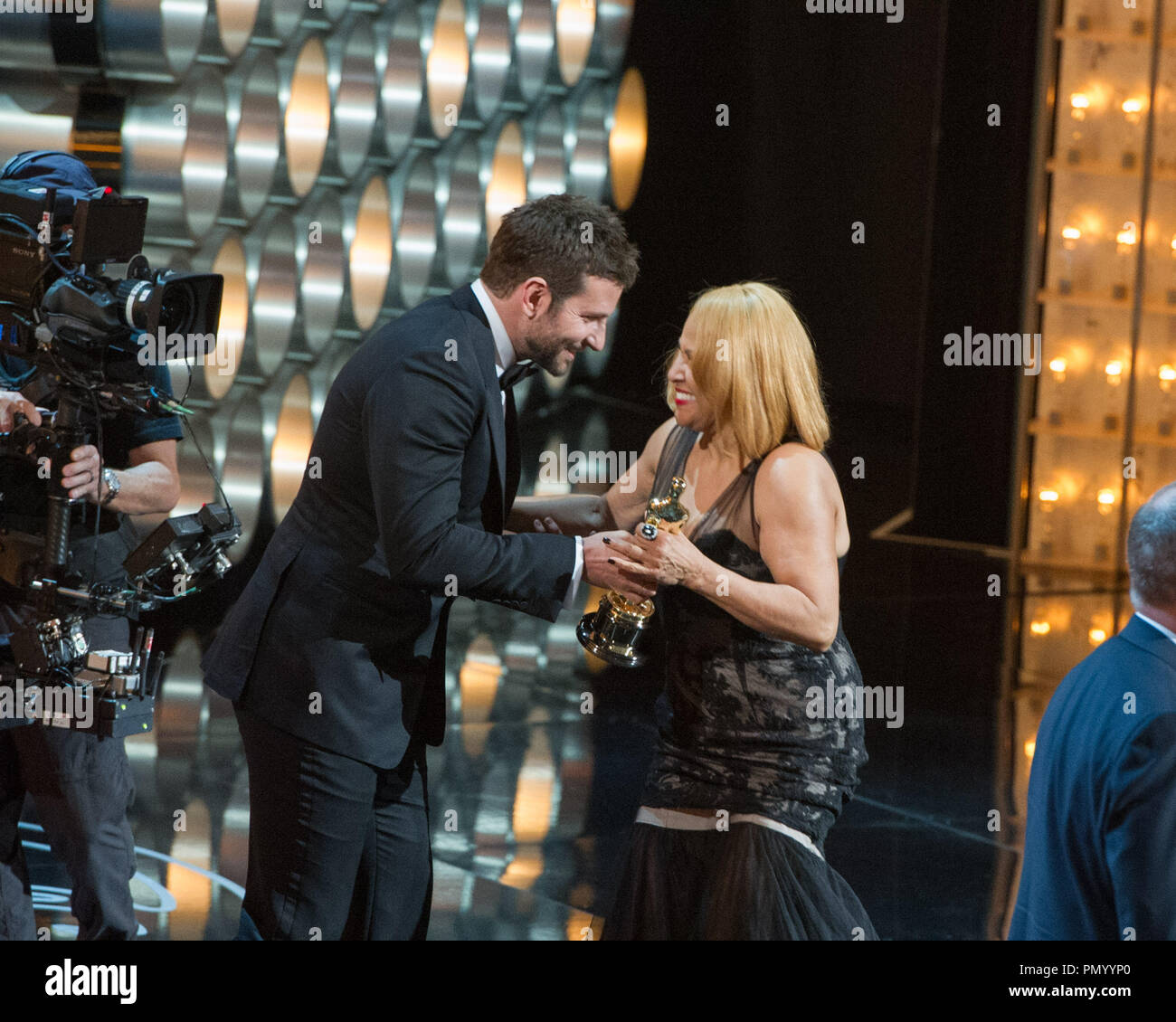 "Singer Darlene Love accepts the Oscar® for the category of Best documentary feature for work on ""20 Feet from Stardom"" from Bradley Cooper during the live ABC Telecast of The Oscars® from the Dolby® Theater in Hollywood, CA Sunday, March 2, 2014.  File Reference # 32268_584  For Editorial Use Only -  All Rights Reserved - Stock Image"