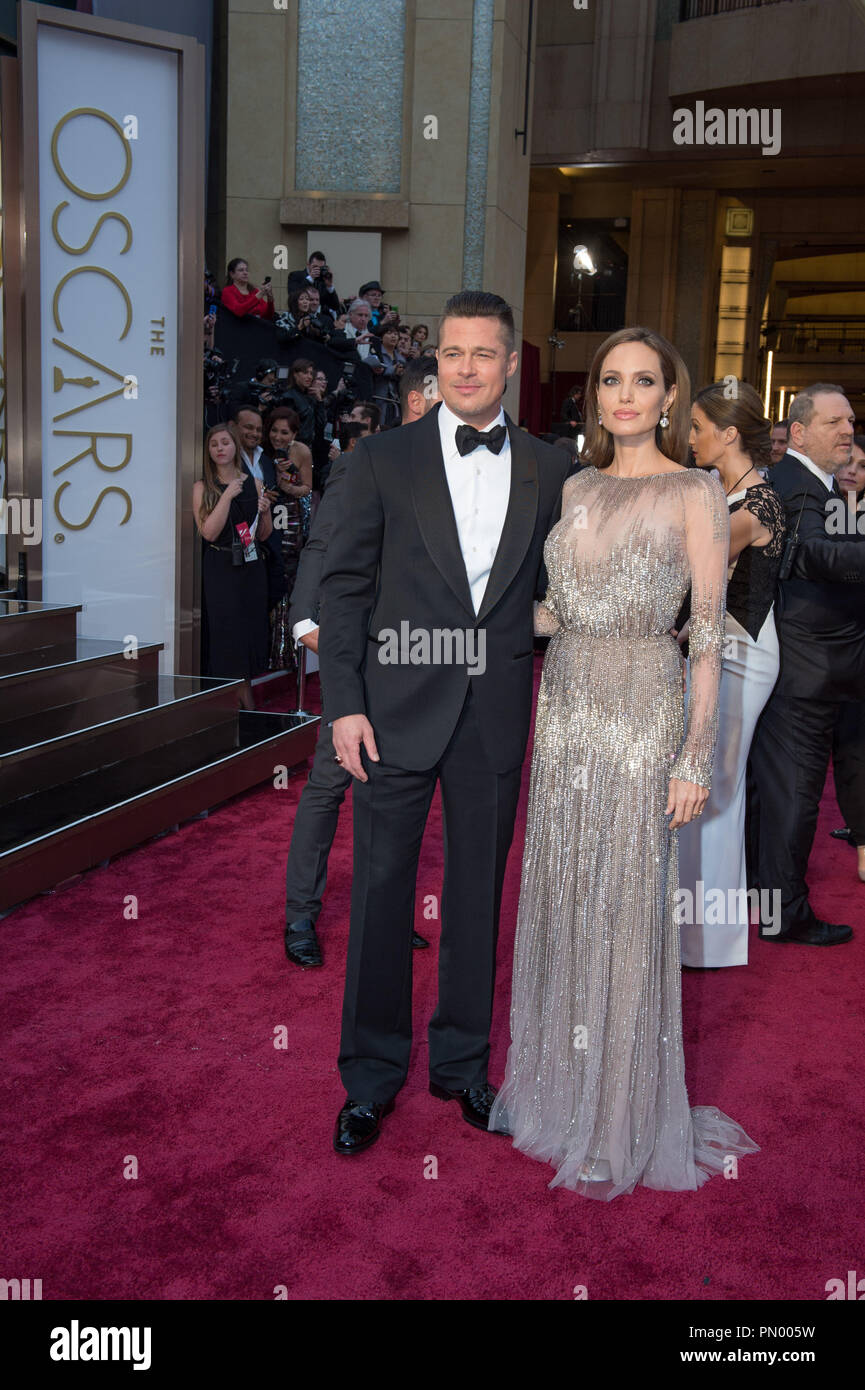 Brad Pitt and Angelina Jolie arrive for the live ABC Telecast of The 86th Oscars® at the Dolby® Theatre on March 2, 2014 in Hollywood, CA.  File Reference # 32268 805  For Editorial Use Only -  All Rights Reserved Stock Photo