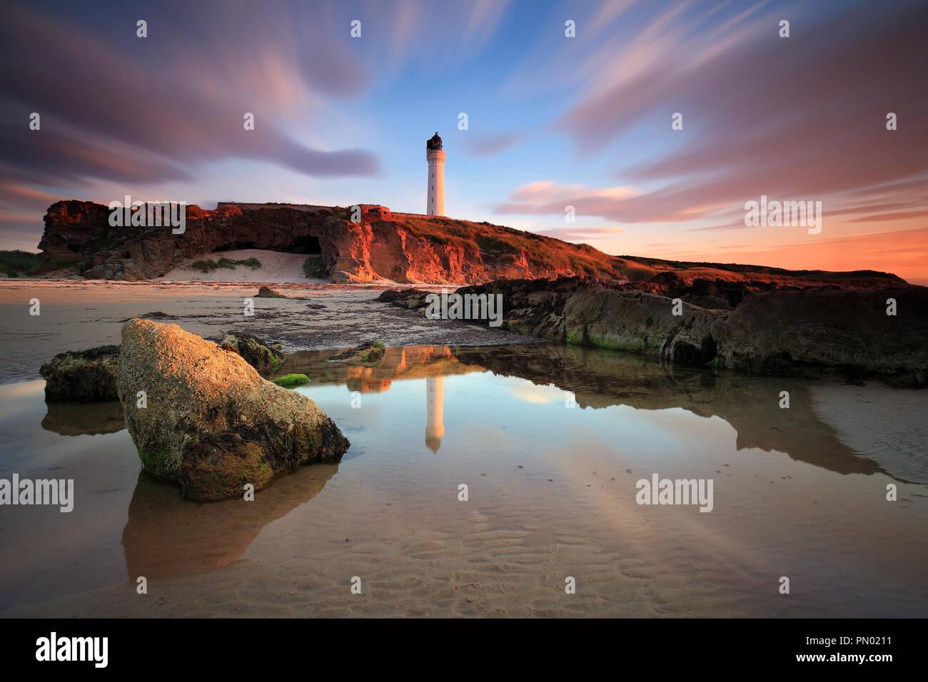 Amazing sunset over Lossiemouth lighthouse (Scotland, UK) - Stock Image
