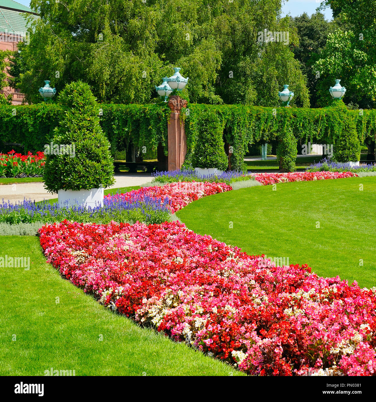 summer park with flower bed and green lawn - Stock Image