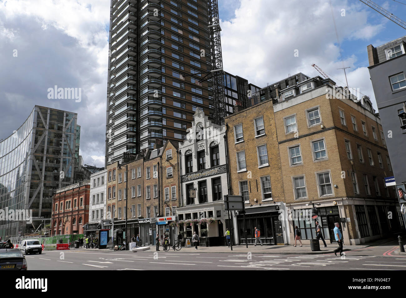 Street view of Norton Folgate and high rise modern Principal Tower in the Tower Hamlets near Spitalfields East London England  UK  KATHY DEWITT - Stock Image
