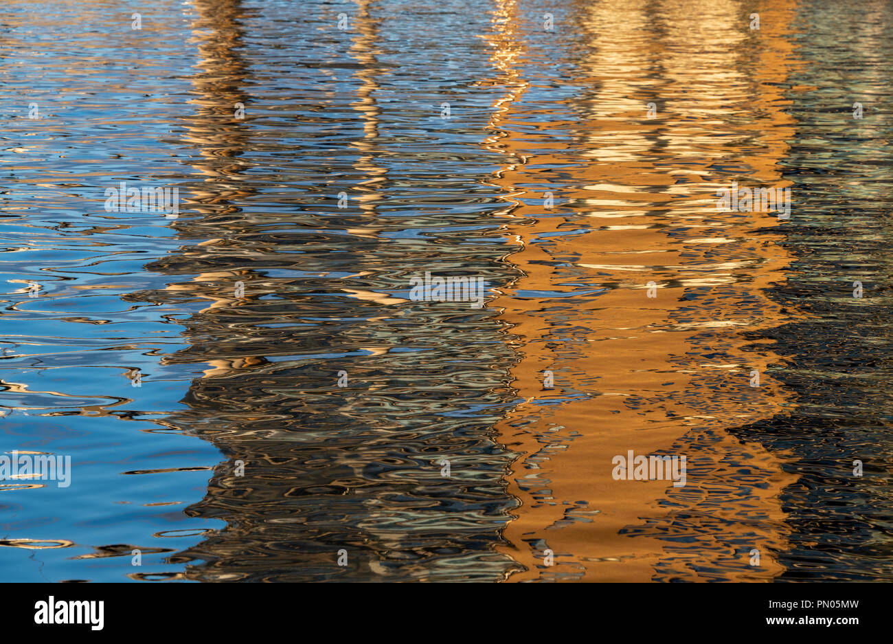 Colourful reflections in water in Stavanger, Norway. Ideal for a background image. - Stock Image
