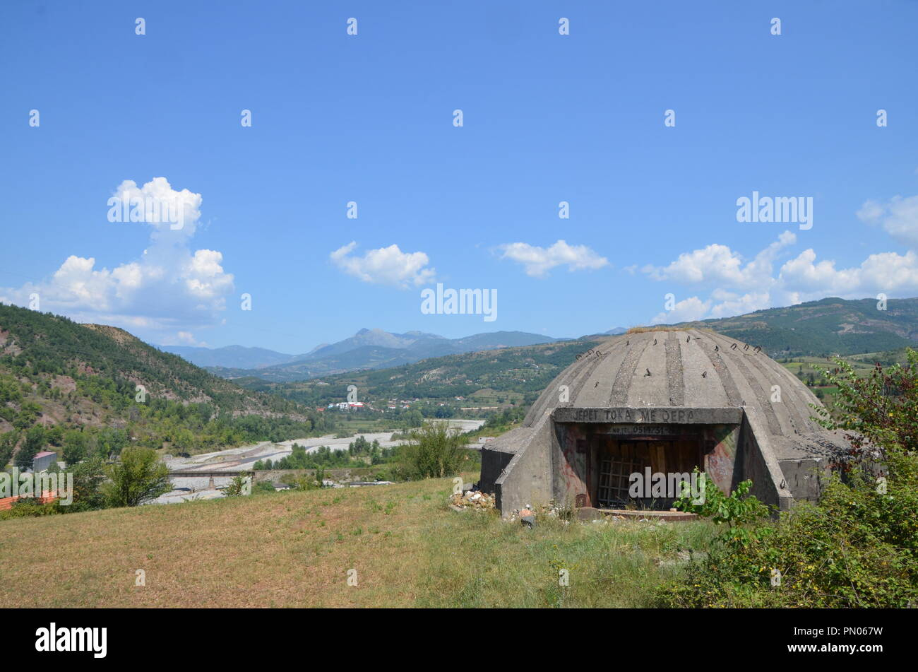 disused abandonned military bunker albania with balkan mountain view - Stock Image
