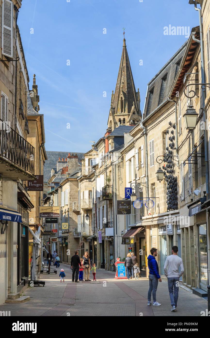 France, Correze, Brive  la Gaillarde, Rue du Lieutenant Colonel Farro (shopping street) and Saint Martin collegiate church bell tower // France, Corrè - Stock Image