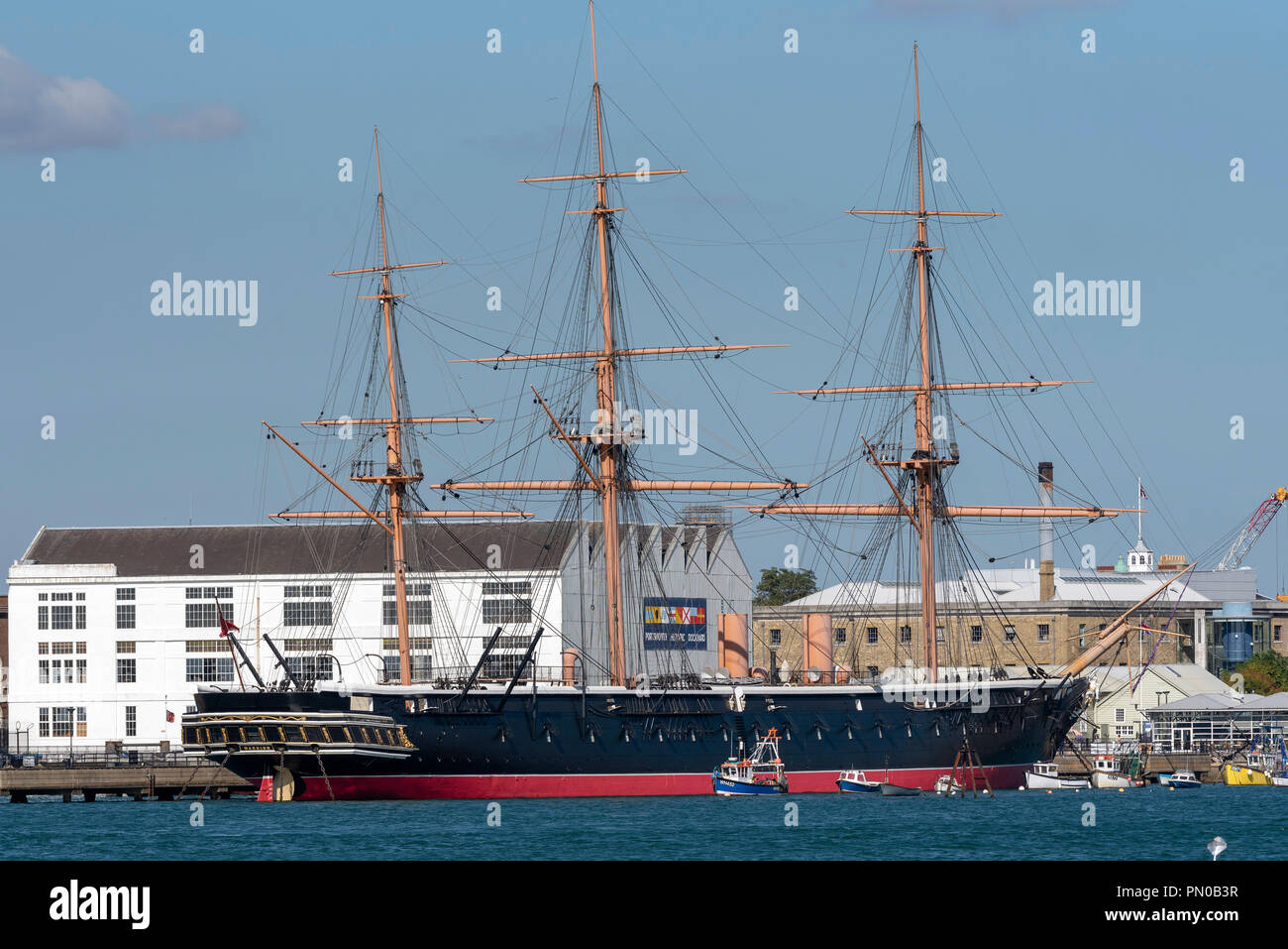 HMS Warrior an iron hulled aroured frigate museum ship on the quay in Portsmouth, England UK Stock Photo