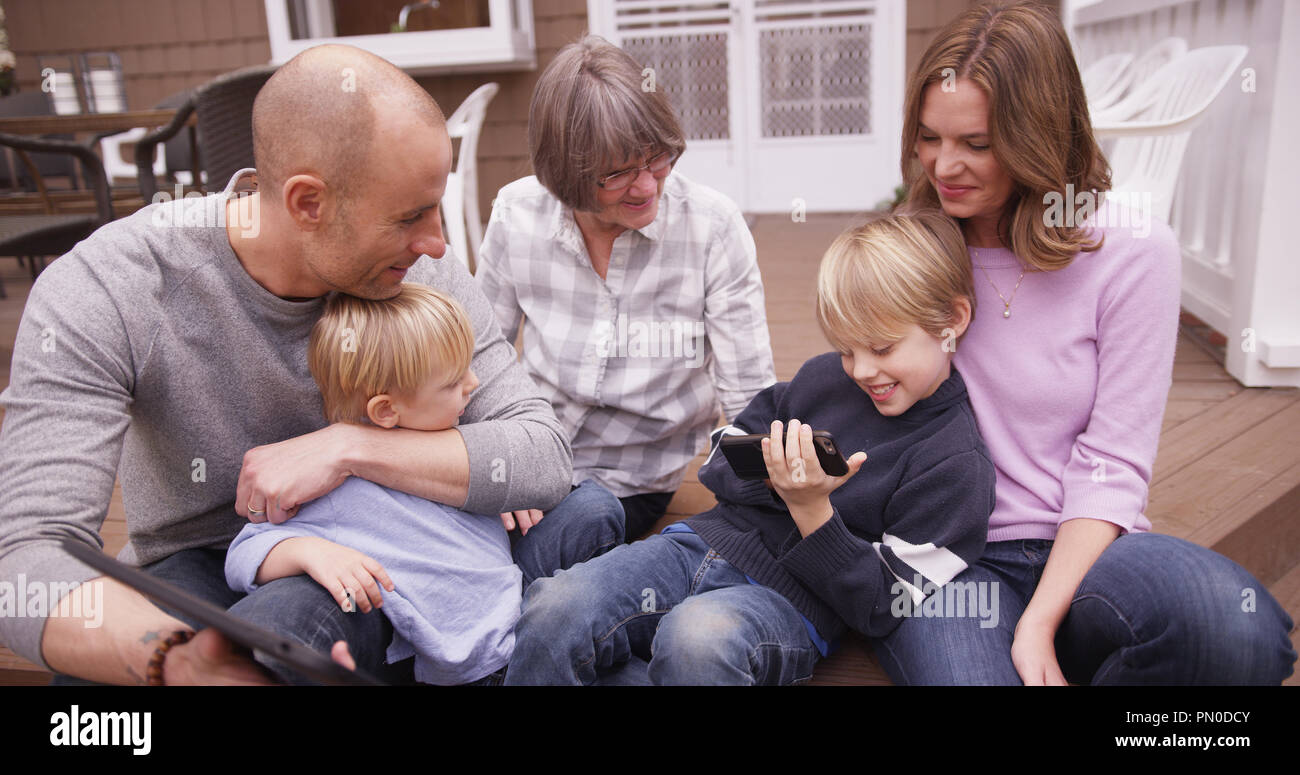 Portrait of happy caucasian family spending time together outdoors. - Stock Image