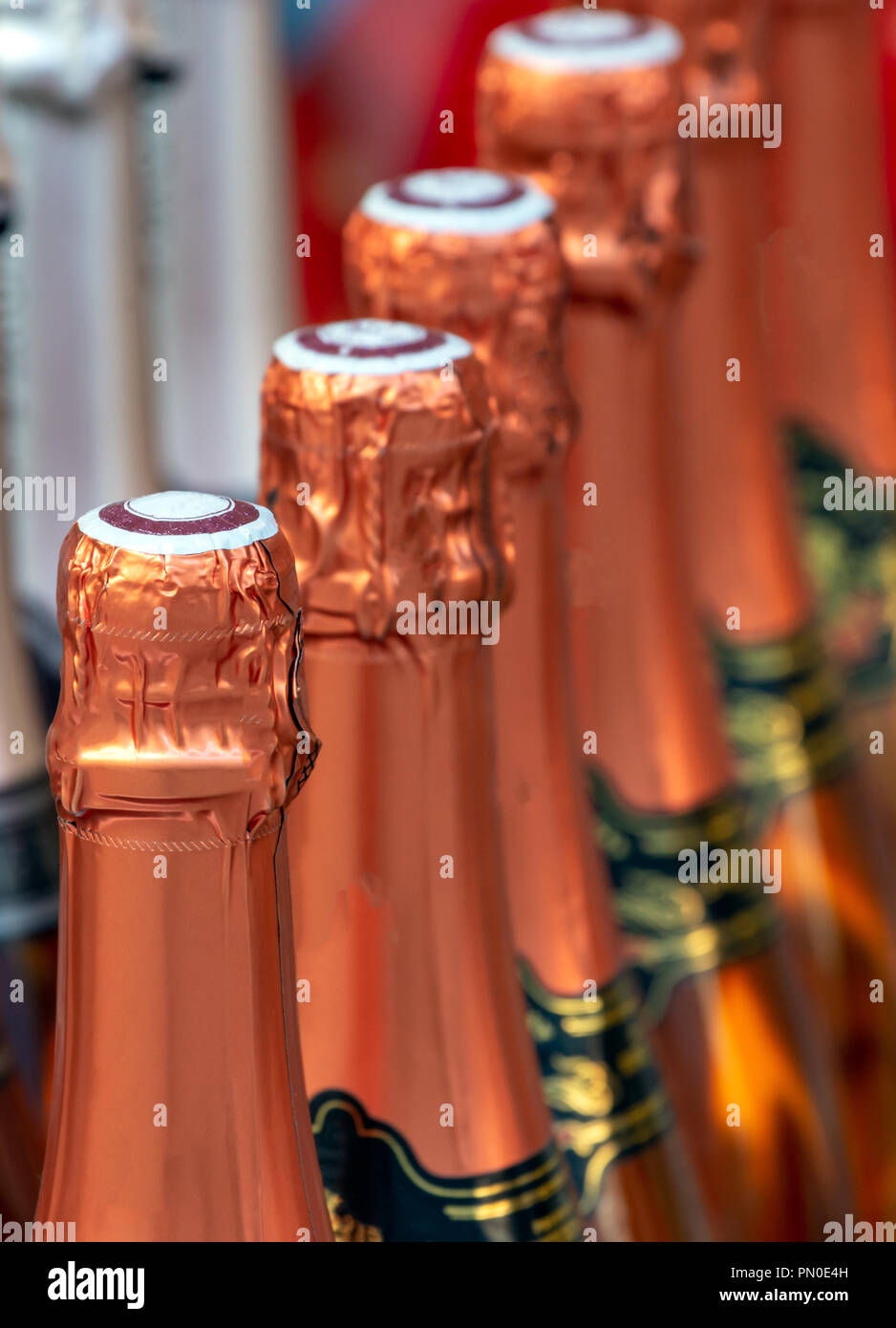 Closeup of a row of champagne bottle necks Stock Photo