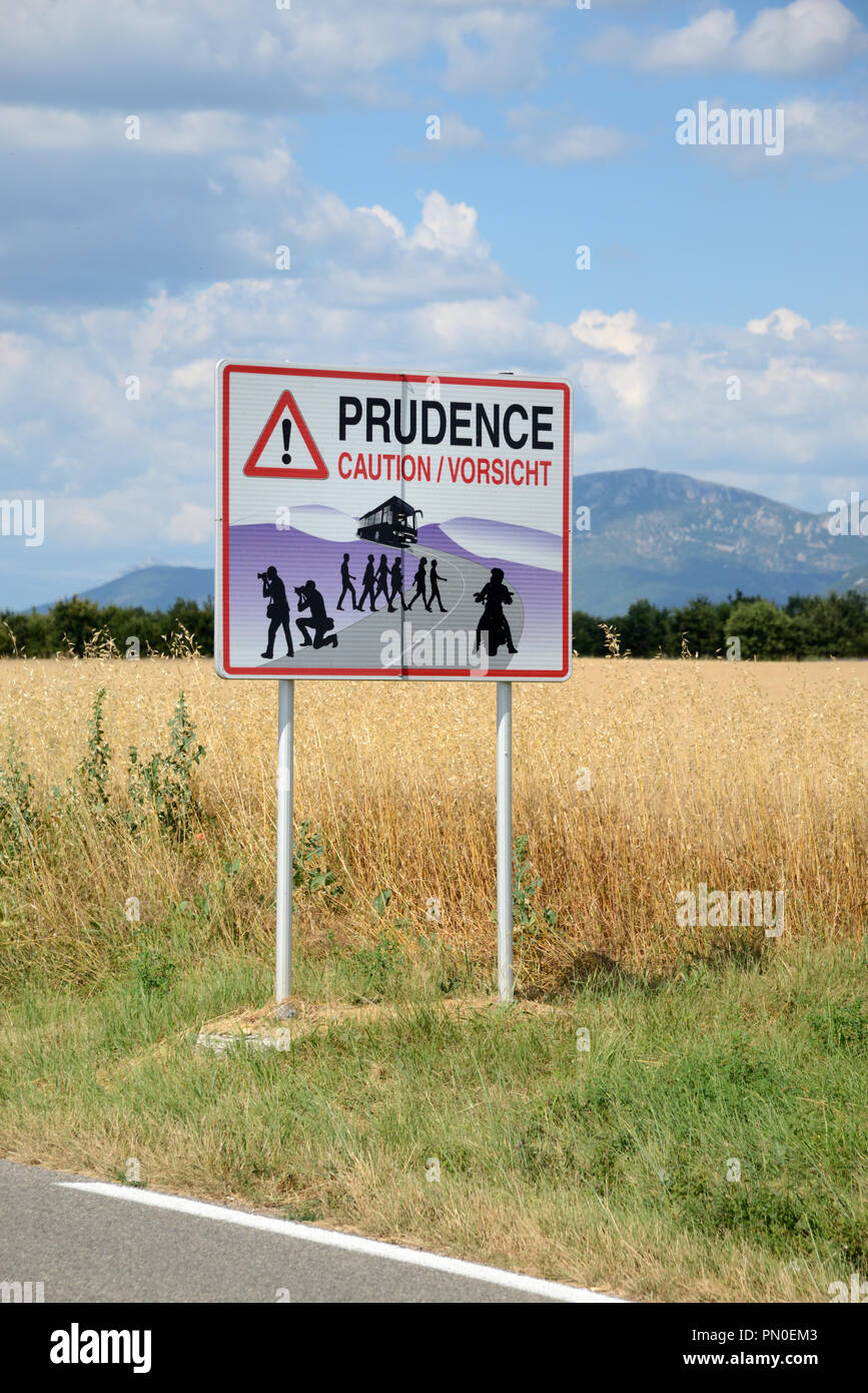 Beware Tourists Traffic Sign Warning Drivers About Tourists on Coach Trips Photographing Lavender Fields on the Valensole Plateau Provence - Stock Image