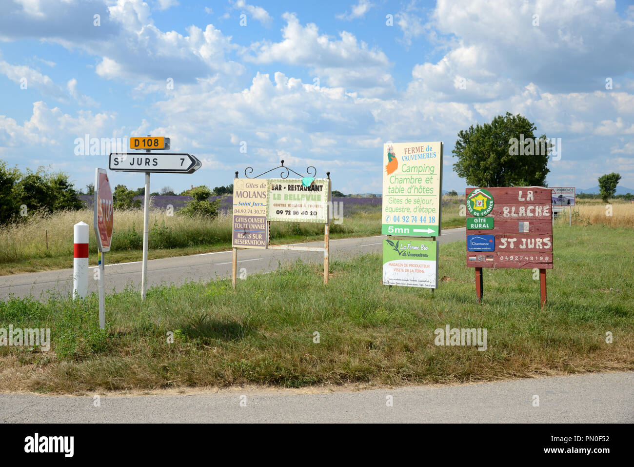 Multitude of Roadside Advertising Panels & Roadside Signs on the Valensole Plateau Provence France - Stock Image
