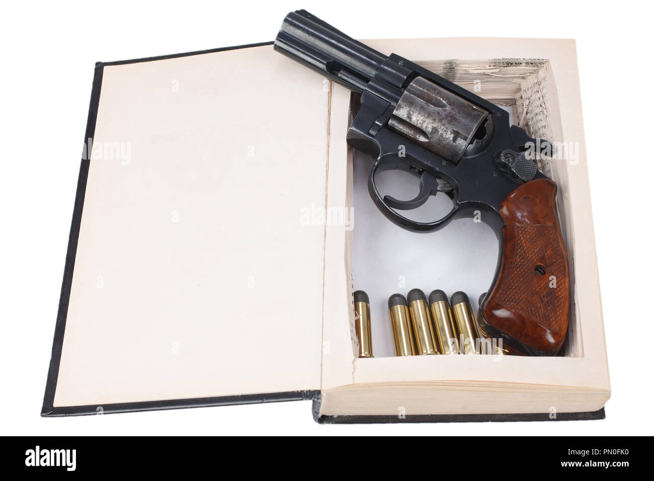 38 caliber revolver gun with cartridges hidden in a book