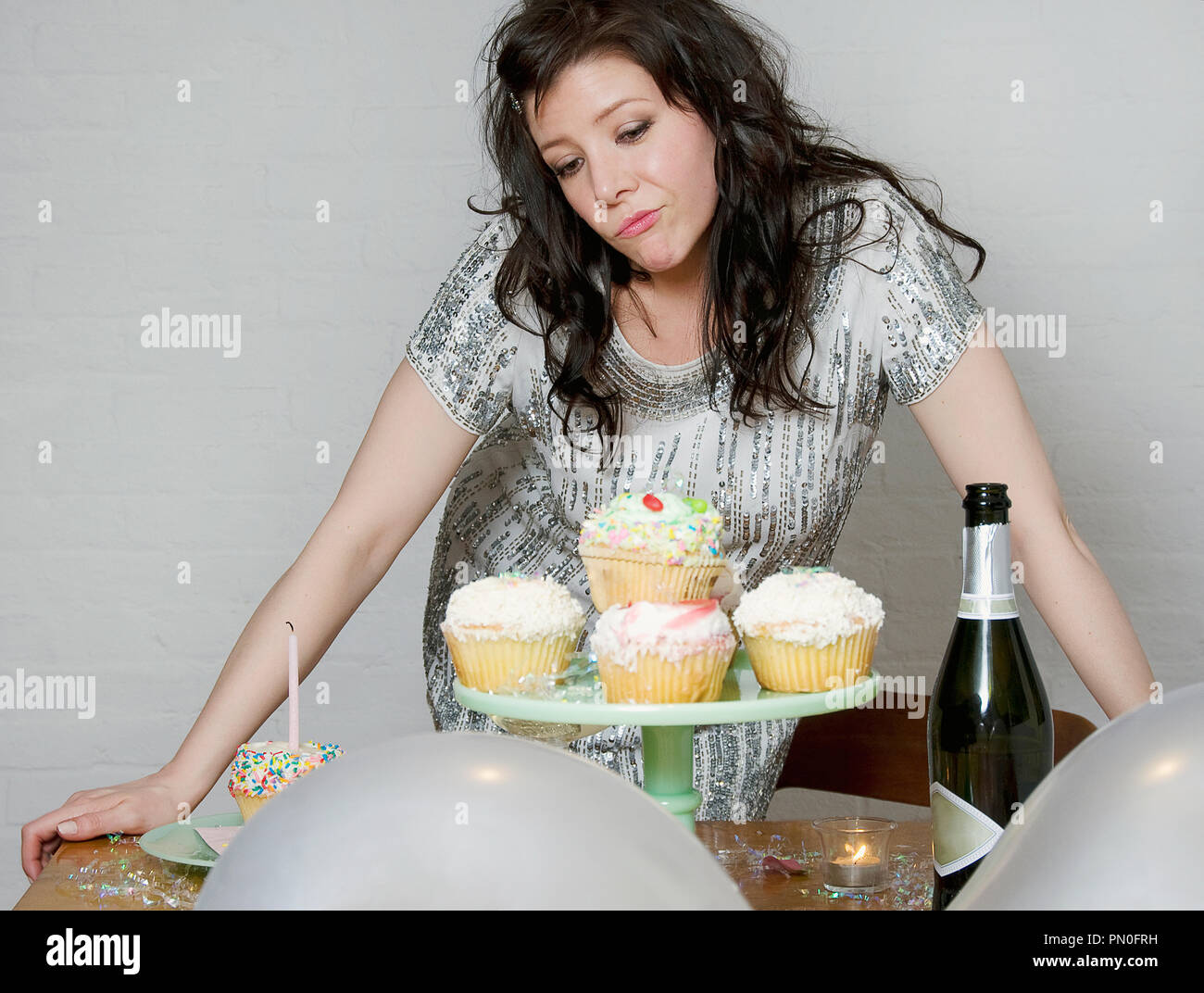 A woman at her birthday party. - Stock Image