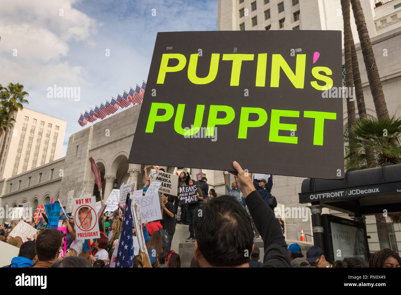 Sign reading 'Putin's Puppet' by anti-Trump protester at Los Angeles City Hall, 2017. - Stock Image