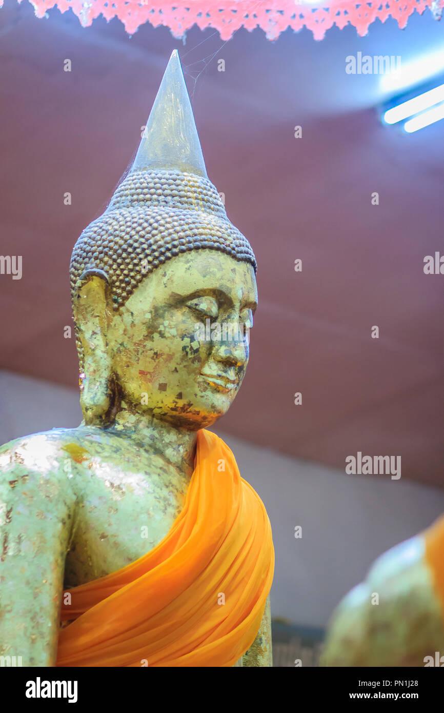 Beautiful golden Buddha statue at Wat Sothorn, Chachoengsao Thailand. - Stock Image