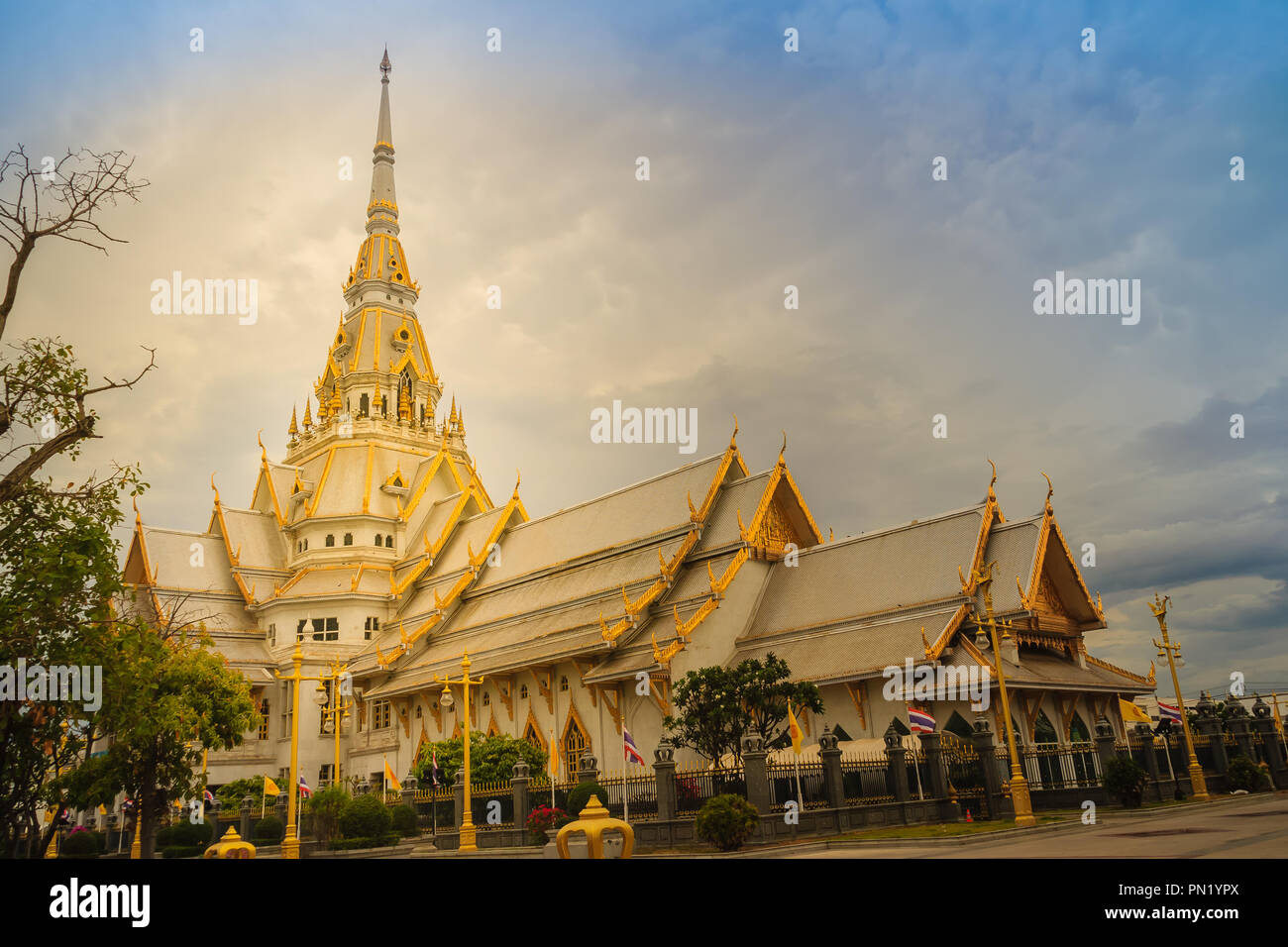 Beautiful golden pagoda at Wat Sothonwararam, a famous public temple in Chachoengsao Province, Thailand. - Stock Image