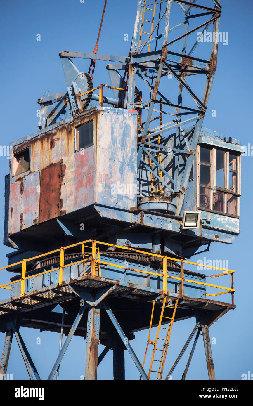 Rusty old gantry crane at the dockside in Cape Town, South Africa - Stock Image