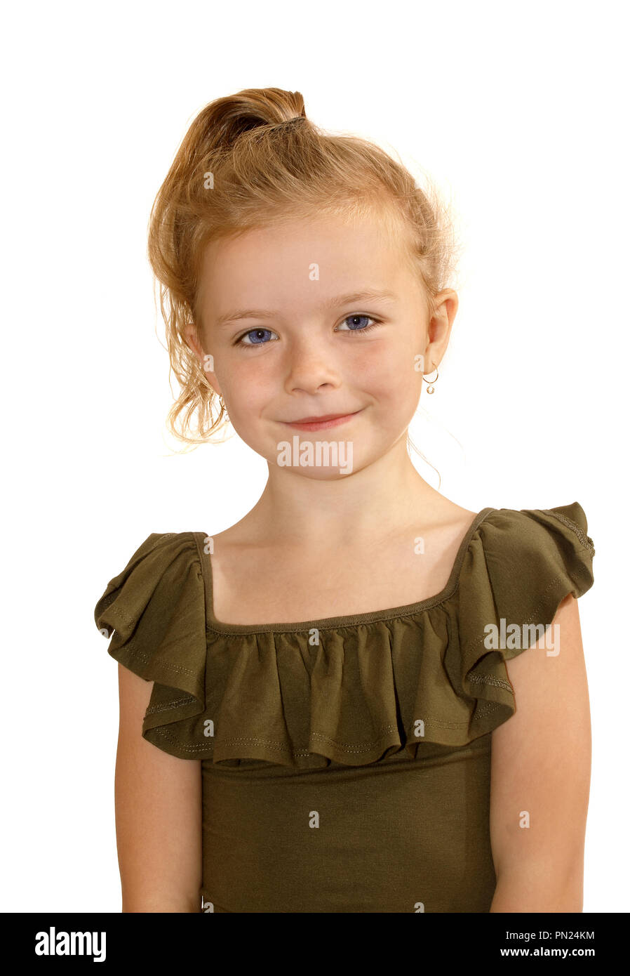Six year old girl smiling towards the camera - Stock Image