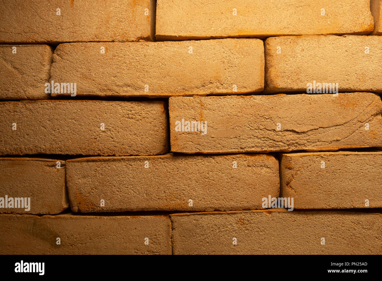 Cracked Dark Red Old Brick Wall Texture. Damaged Brown Abstract Blank Stonewall Background. Ruinous Brickwall Dilapidation In Places Covered With Moss - Stock Image