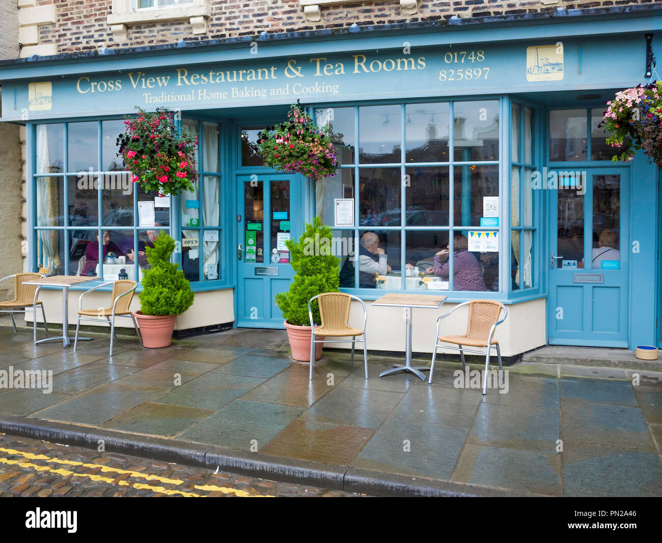 Cross View Café and Tea Rooms overlooking the stone cross in the Market place in Richmond North Yorkshire England UK Stock Photo