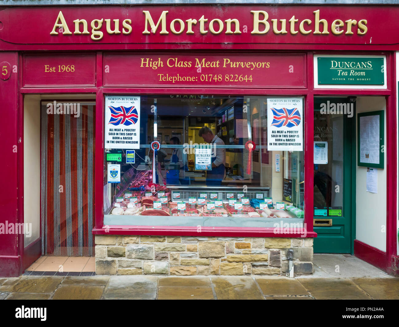 Angus Morton Butchers a traditional butcher shop specialising in UK bred meat and poultry in Richmond North Yorkshire UK - Stock Image